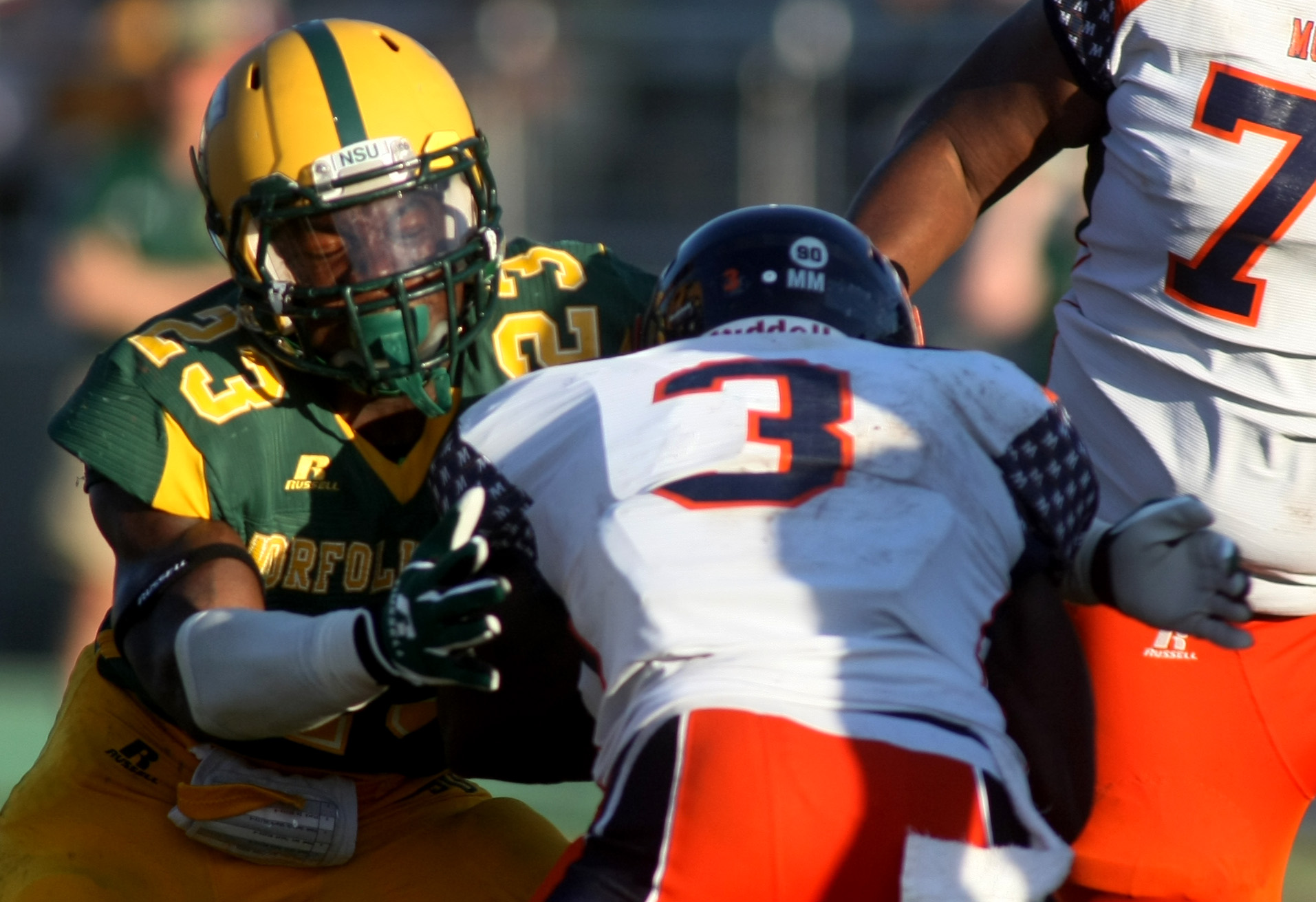 Norfolk State's Marcell Coke, left, tackles Morgan State's Herb Walker, Jr during NSU's 15-14 win, Saturday, Sept. 27, 2014 at Dick Price Stadium in Norfolk.  (Jason Hirschfeld | For The Virginian-Pilot)