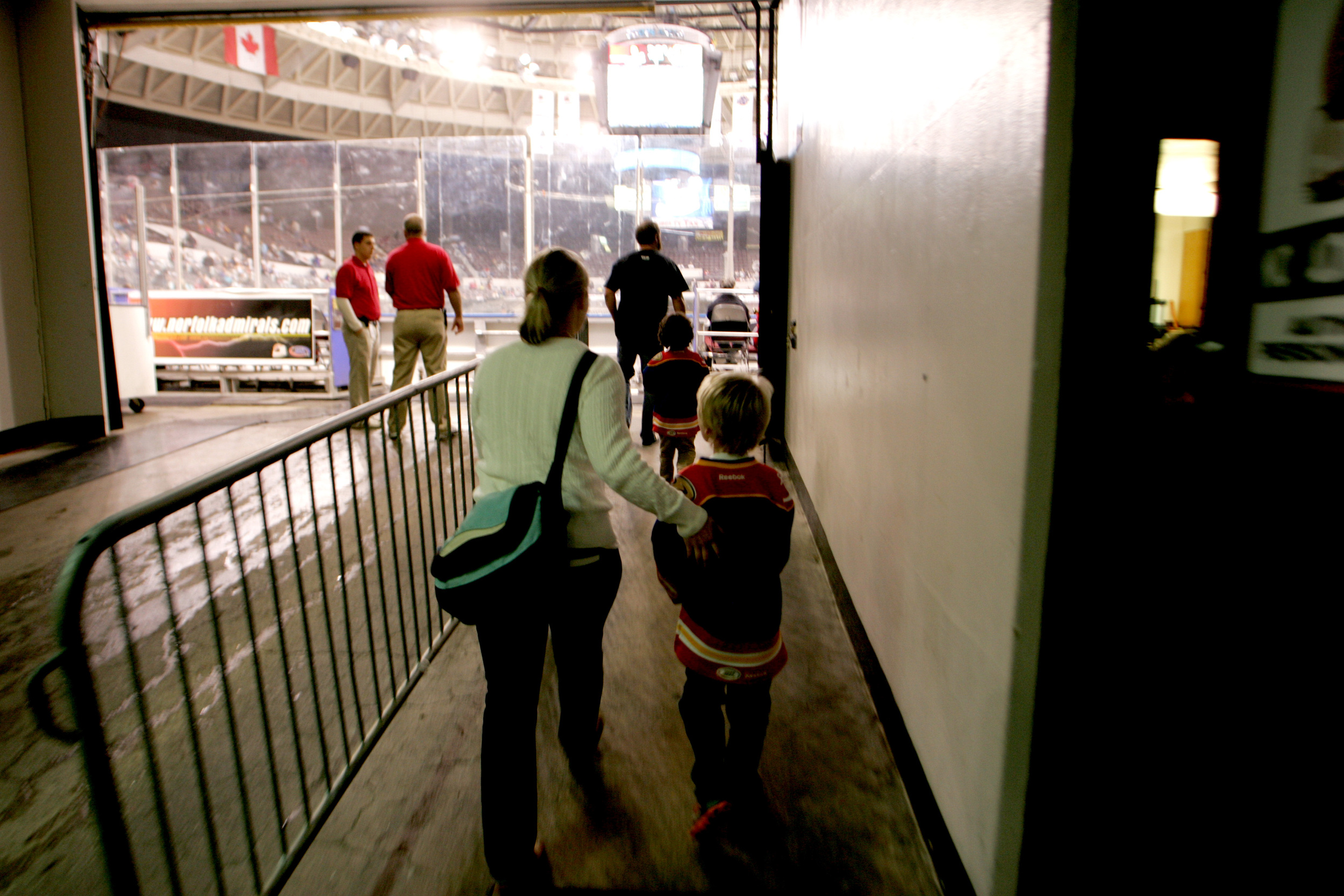 Max Tarantino, 7, walks up the ramp with his mom, Rebecca Hall, to their seats behind the glass before the start of the Admirals' home opener against Hershey, Saturday, Oct. 11, 2014 at Scope in Norfolk.    (Jason Hirschfeld | For The Virginian-Pilot)