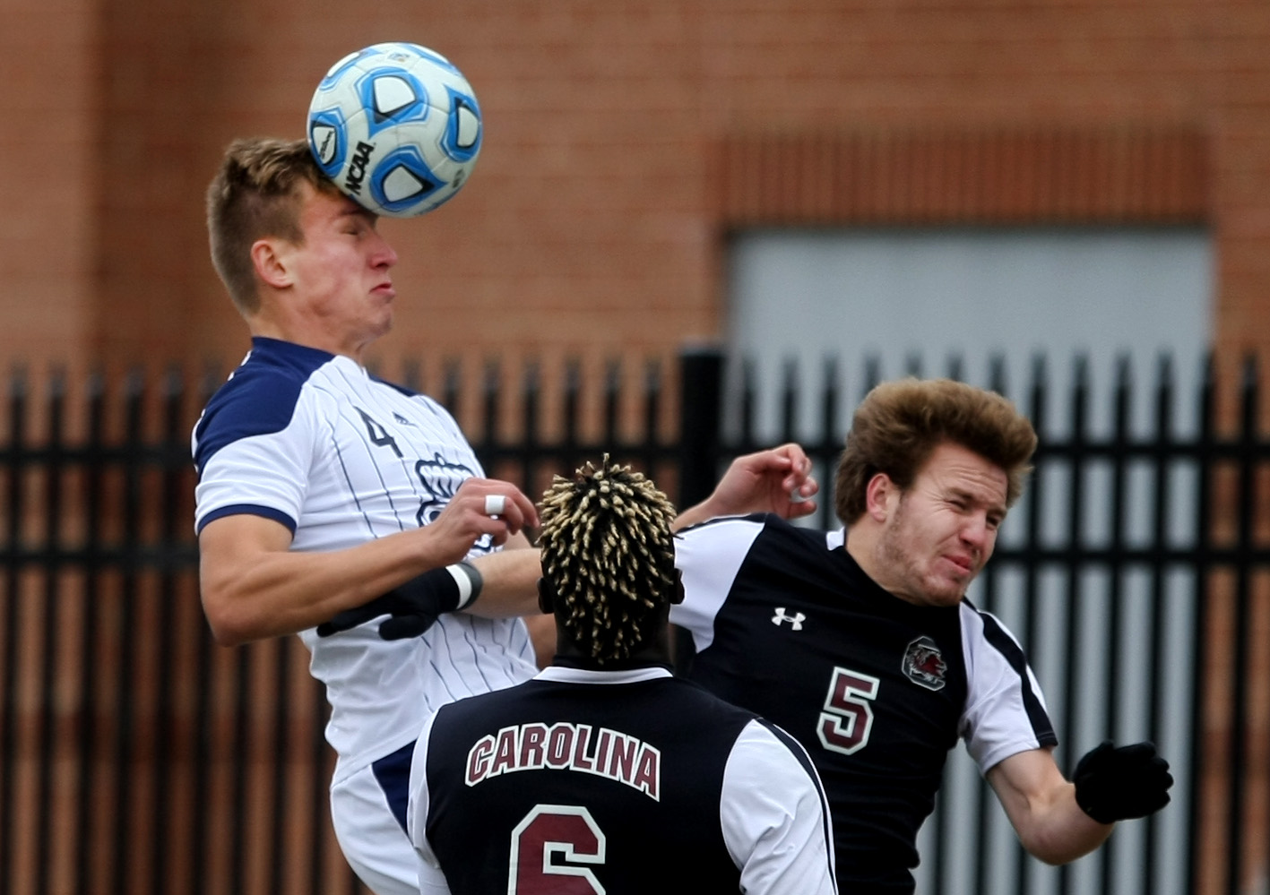 Old Dominion's David Macsicza, left, heads a ball out of the box away from University of South Carolina's Mahamoudou Kaba (cq), center, and Koty Millard during second half action of ODU's 2-1 win over USC to claim the Conference USA Men's Soccer Final, Sunday, Nov. 16, 2014 at ODU in Norfolk.  (Jason Hirschfeld | For The Virginian-Pilot)