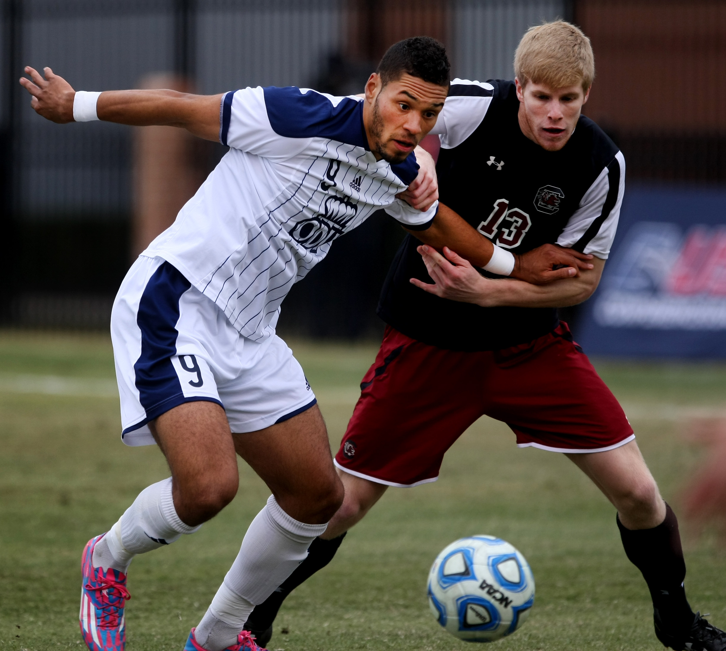 Old Dominion's Sidney Rivera, left, and University of South Carolina's Braeden Troyer battle for possession during first half action of ODU's 2-1 win over USC to claim the Conference USA Men's Soccer Final, Sunday, Nov. 16, 2014 at ODU in Norfolk.  (Jason Hirschfeld | For The Virginian-Pilot)