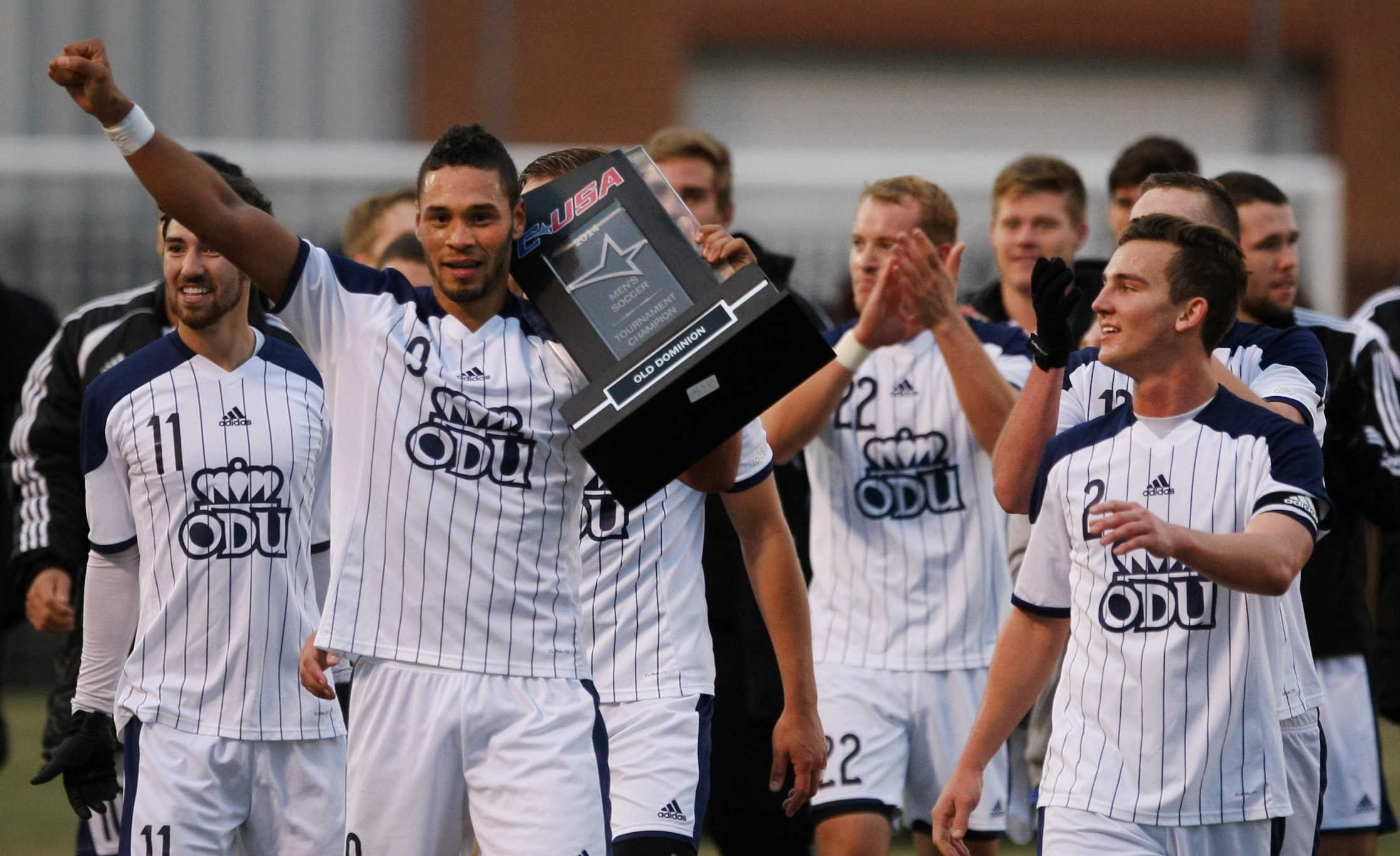 Old Dominion players, led by Sidney Rivera (with arm out) celebrate after ODU's 2-1 win over University of South Carolina to claim the Conference USA Men's Soccer Final, Sunday, Nov. 16, 2014 at ODU in Norfolk.  (Jason Hirschfeld | For The Virginian-Pilot)