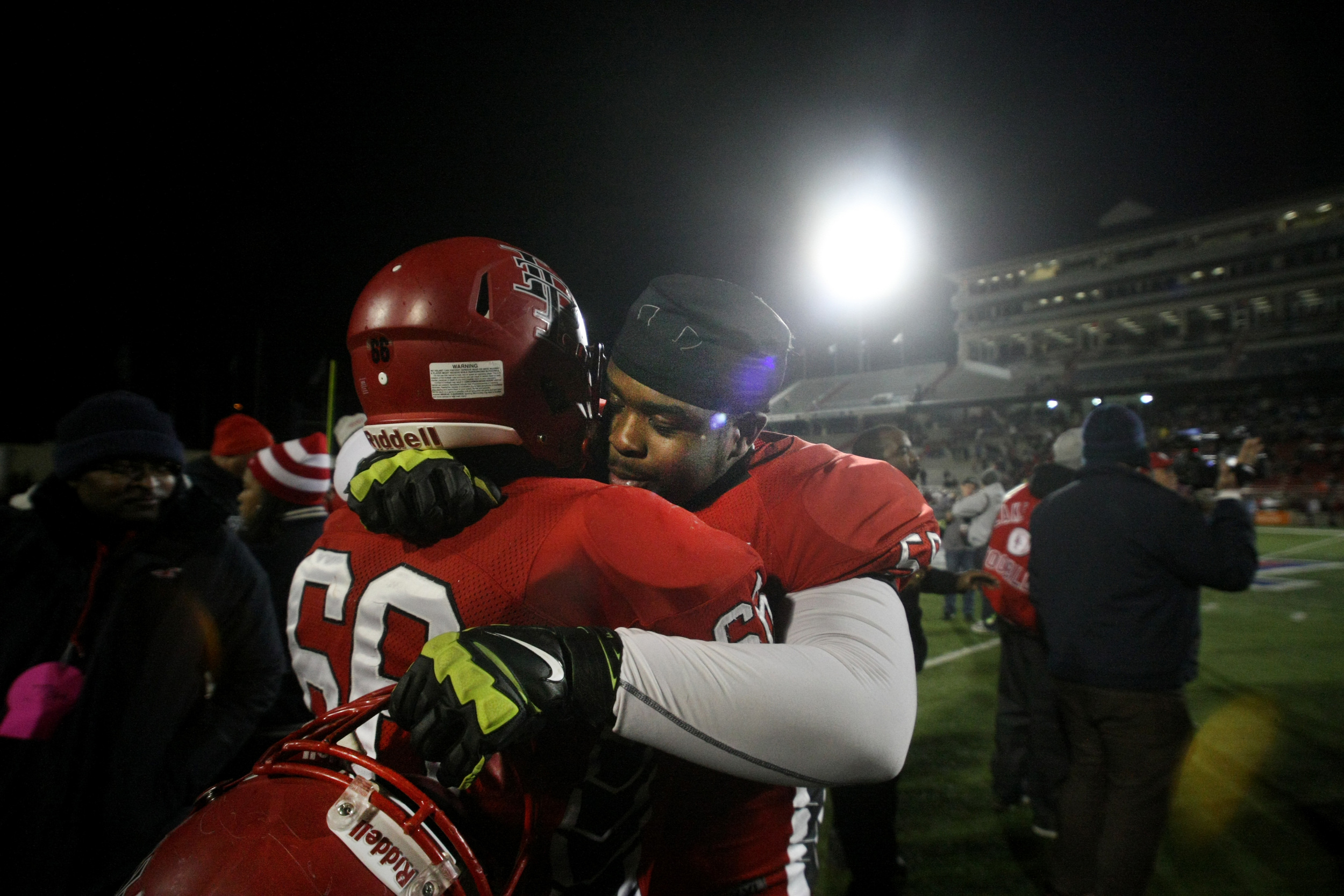 Lake Taylor's Brian Moore, right, celebrates with teammate Anthony Williams after the Titans beat Salem 41-16 to win the Group 4A South championship, Saturday, Dec. 13, 2014 at Williams Field in Lynchburg.  (Jason Hirschfeld | For The Virginian-Pilot)