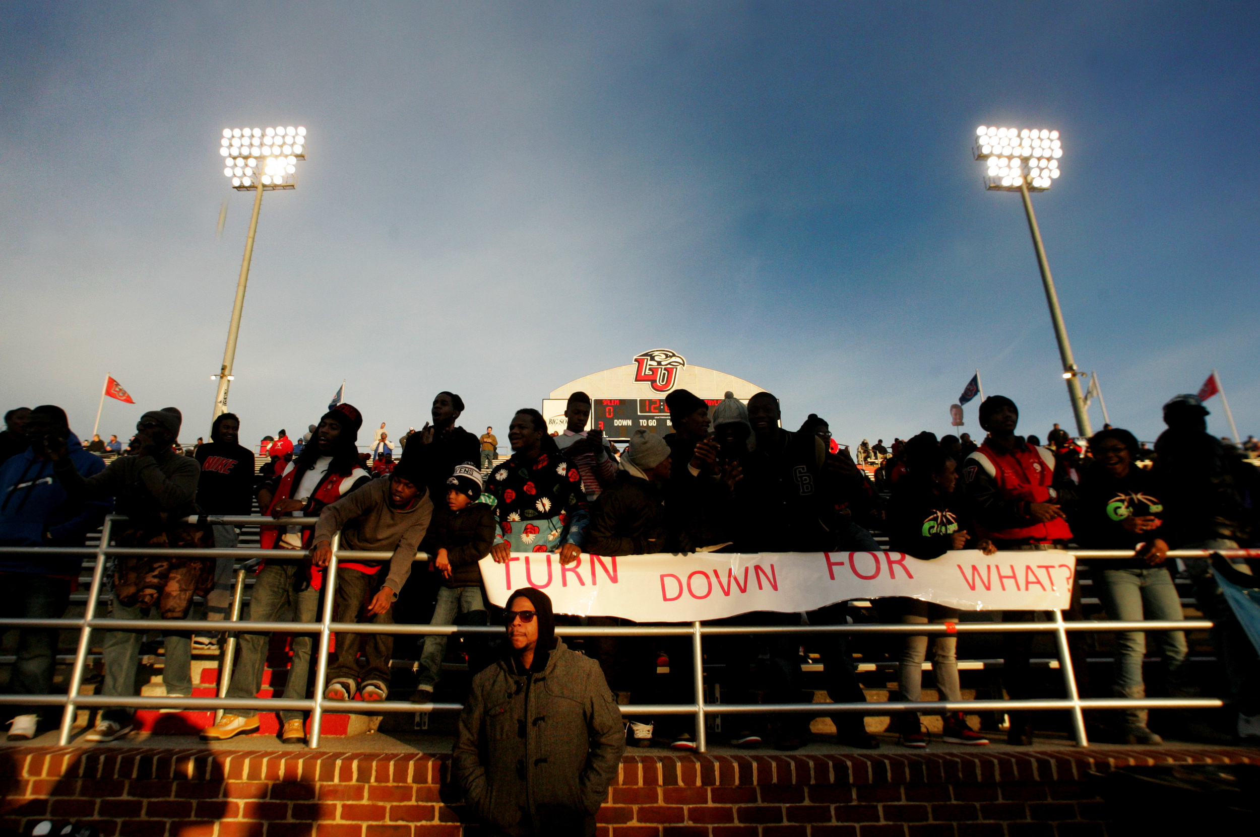 Demarius Wilson, a school administrator, waits for the Lake Taylor Titans to enter field prior to the start of their championship game against Salem, Saturday, Dec. 13, 2014 at Liberty University in Lynchburg.