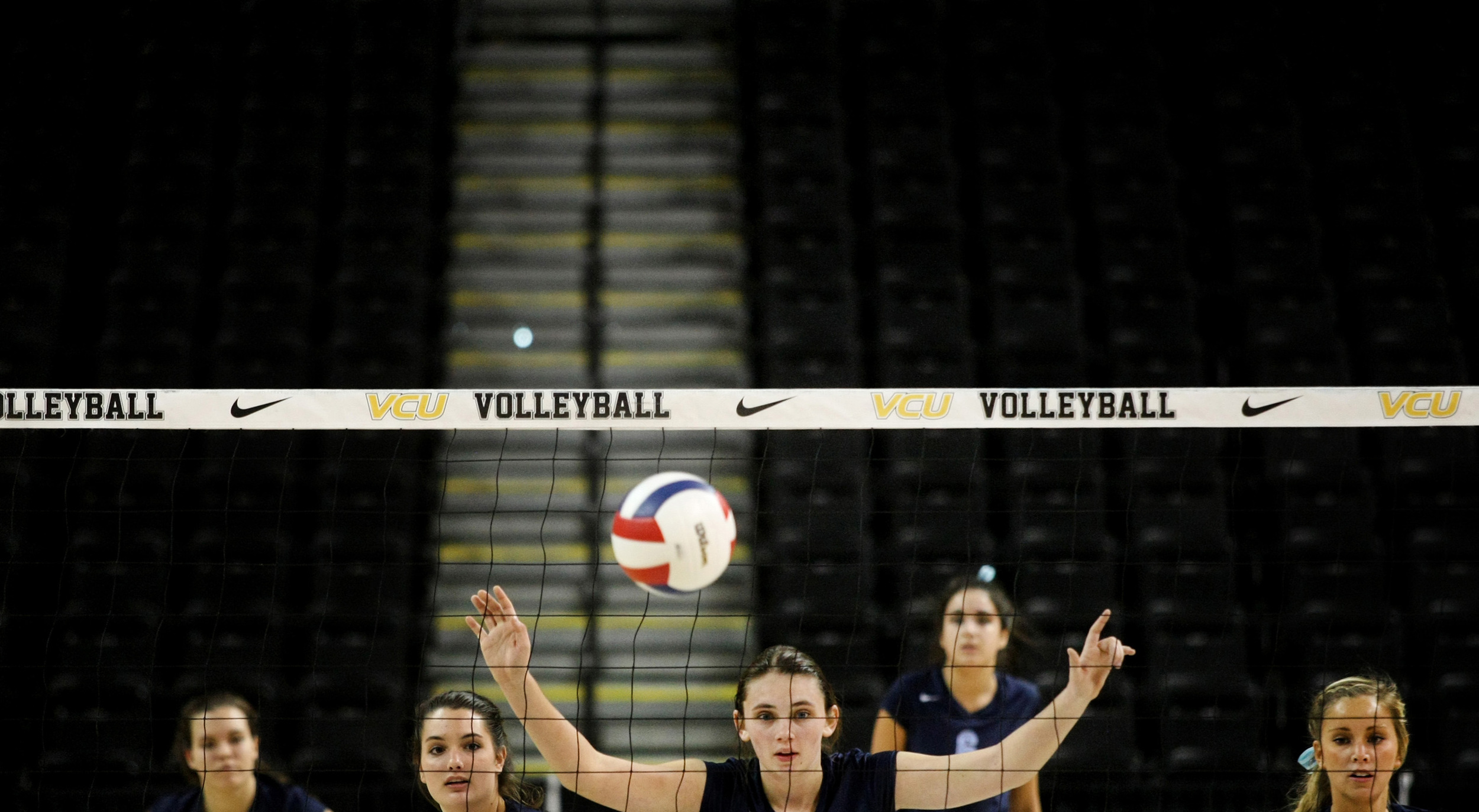 First Colonial's offense awaits a James Madison serve in the fifth set of which First Colonial would win to beat James Madison to claim the Group 6A girls volleyball championship, Friday, Nov. 21, 2014 at the Siegel Center in Richmond.  (Jason Hirschfeld   For The Virginian-Pilot)