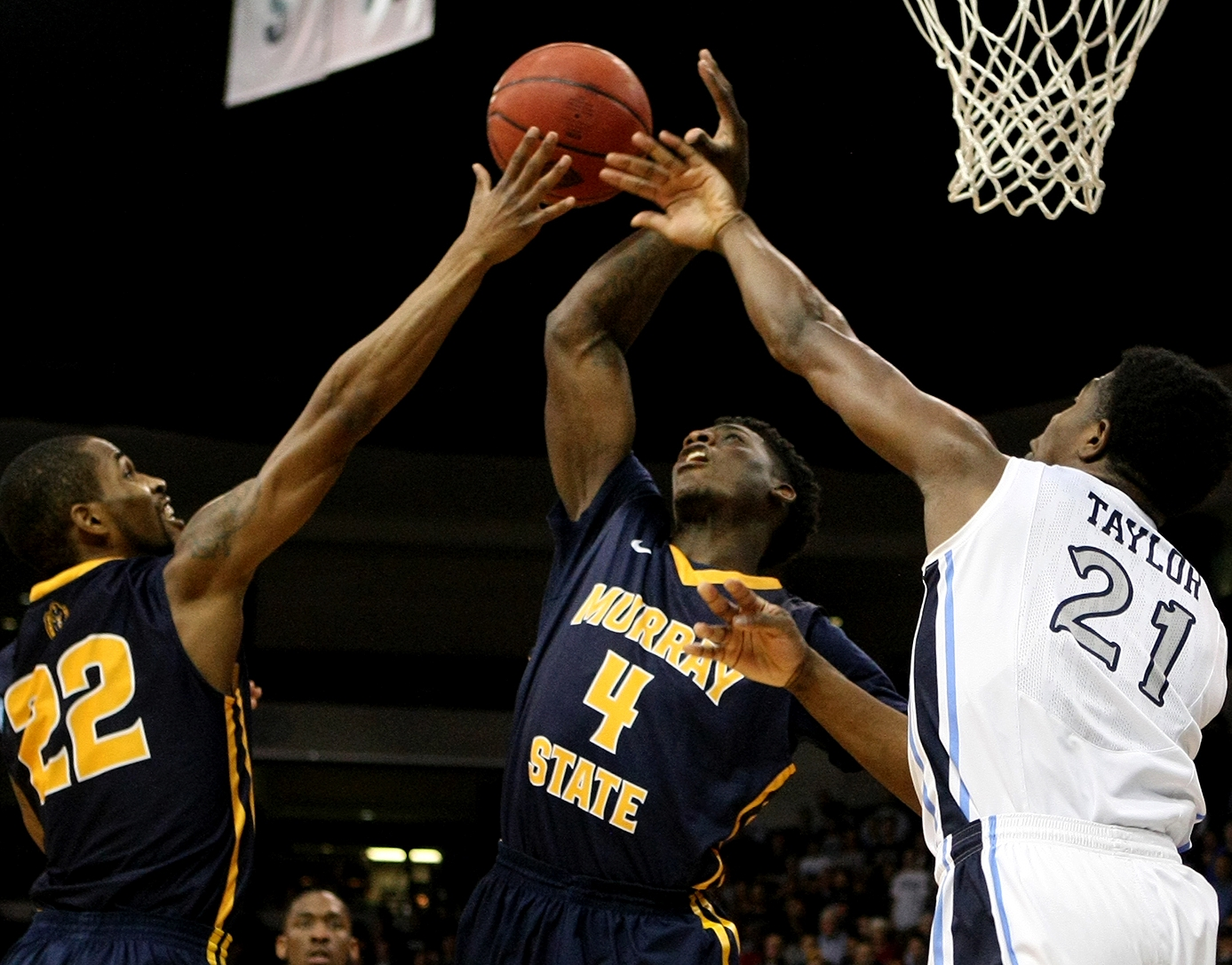 Murray State's T.J. Sapp (22), Jarvis Williams (4) battle Old Dominion's Denzell Taylor for a loose ball during the first half of an NCAA college basketball game in the National Invitation Tournament, Wednesday, March 25, 2015 in Norfolk, Va.  (AP Photo/Jason Hirschfeld)