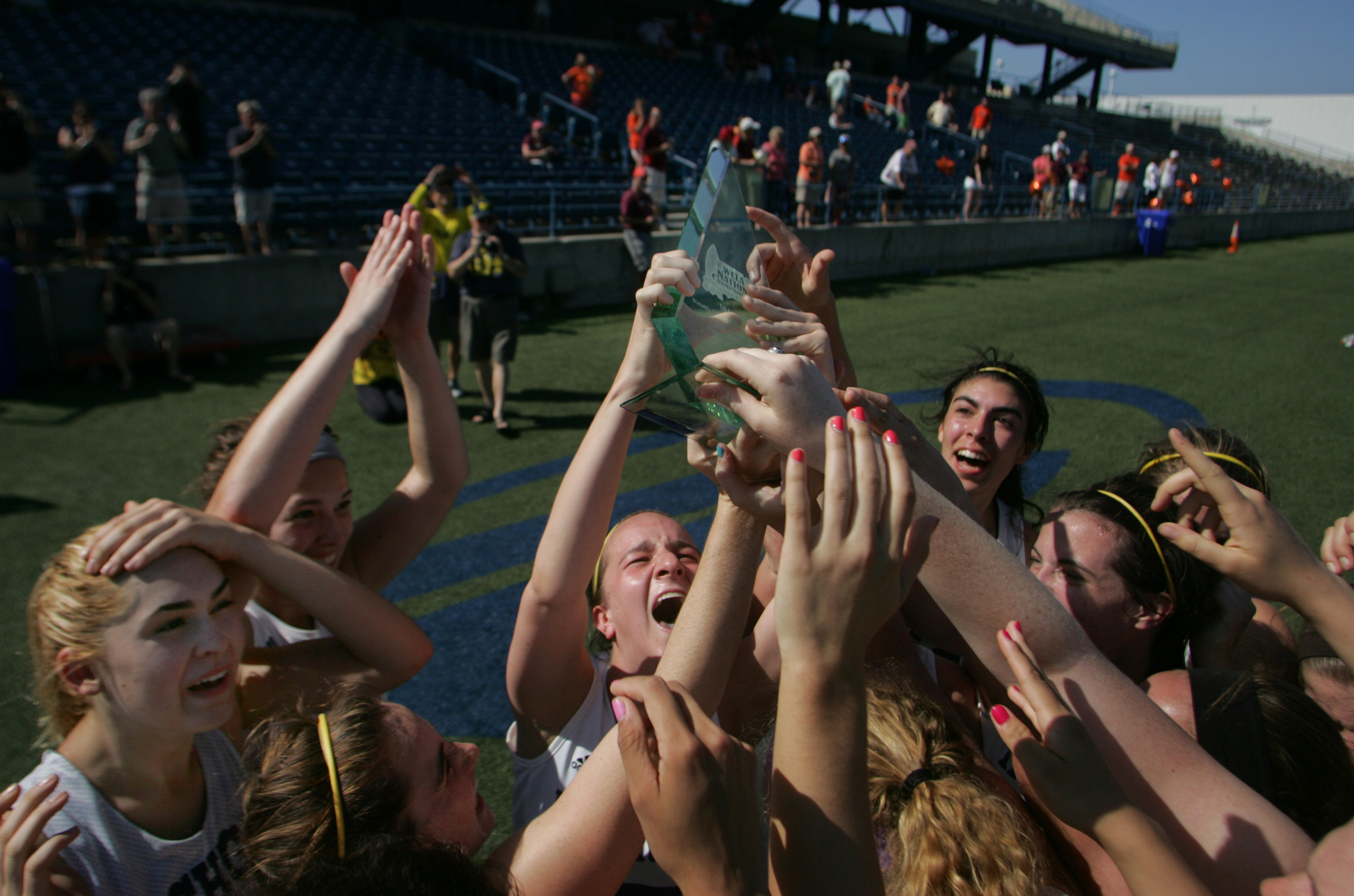 The Michigan women's lacrosse team celebrates after beating Virginia Tech 8-3 to win the national championship, Saturday, May 9, 2015 at the Sportsplex in Virginia Beach.