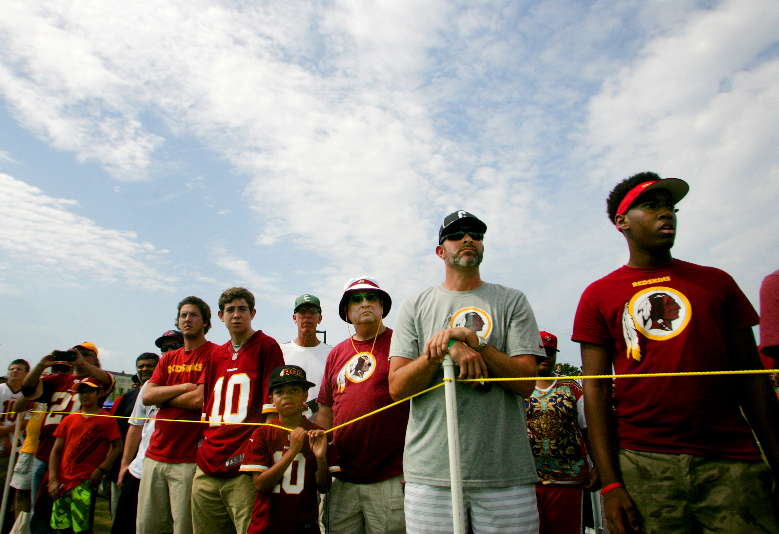 Washington Redskins fans watch from the sidelines during the team's NFL football training camp in Richmond, Va., Thursday, July 30, 2015. (AP Photo/Jason Hirschfeld)