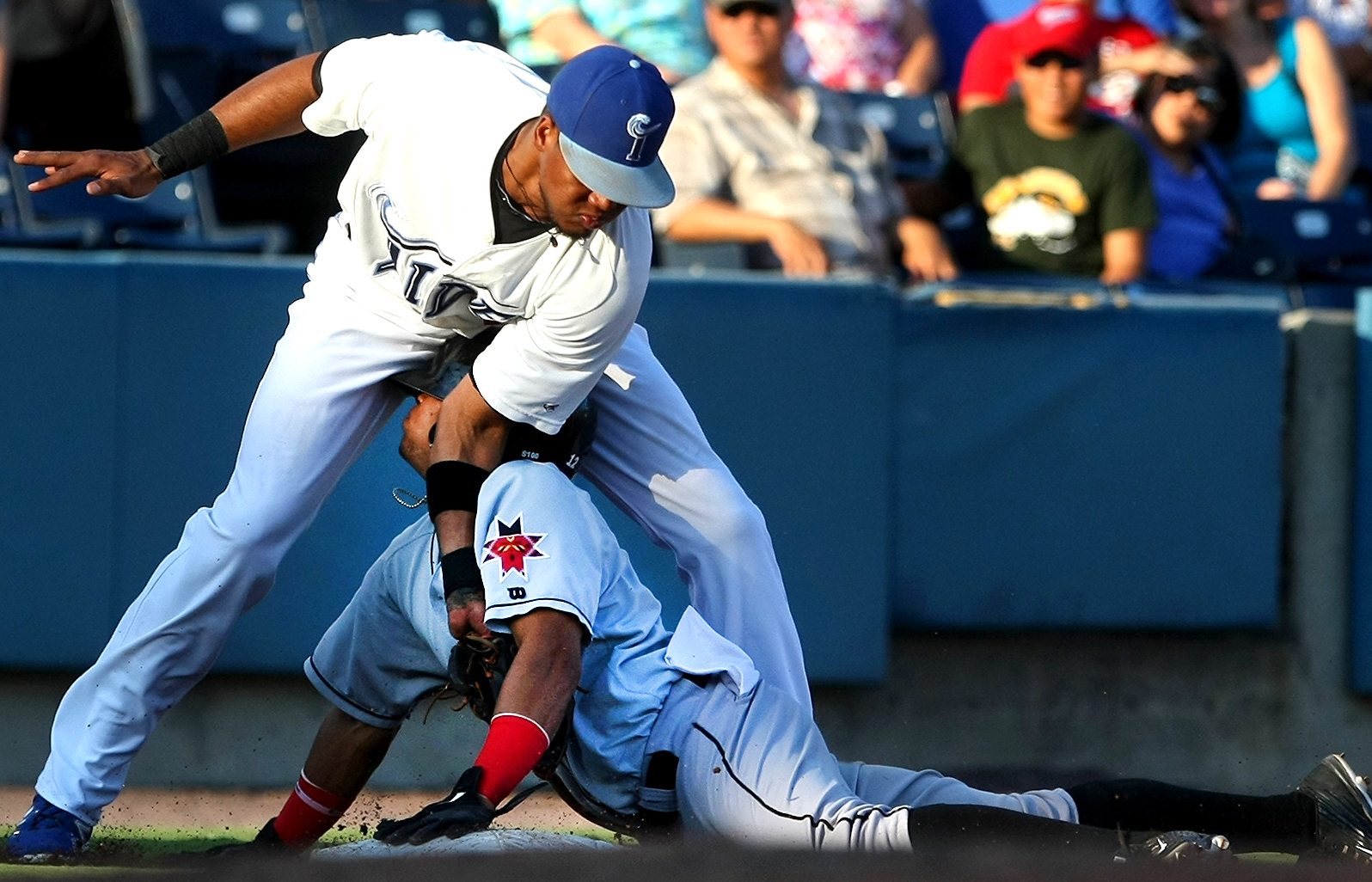 Tides third baseman Michael Almanzar tags out Indianapolis's Gustavo Nunez in the top of the third inning, Sunday, Aug. 9, 2015 at Harbor Park in Norfolk. (AP Photo/Jason HIrschfeld)