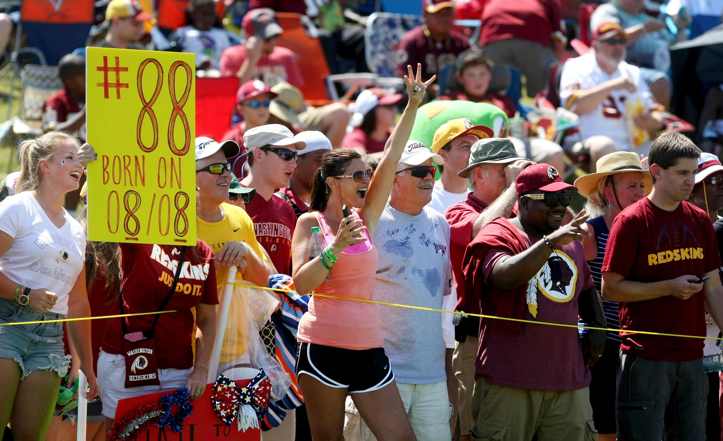 Washington Redskins fans line the sidelines during the team's NFL football training camp in Richmond, Va., Saturday, August 1, 2015. (AP Photo/Jason Hirschfeld)