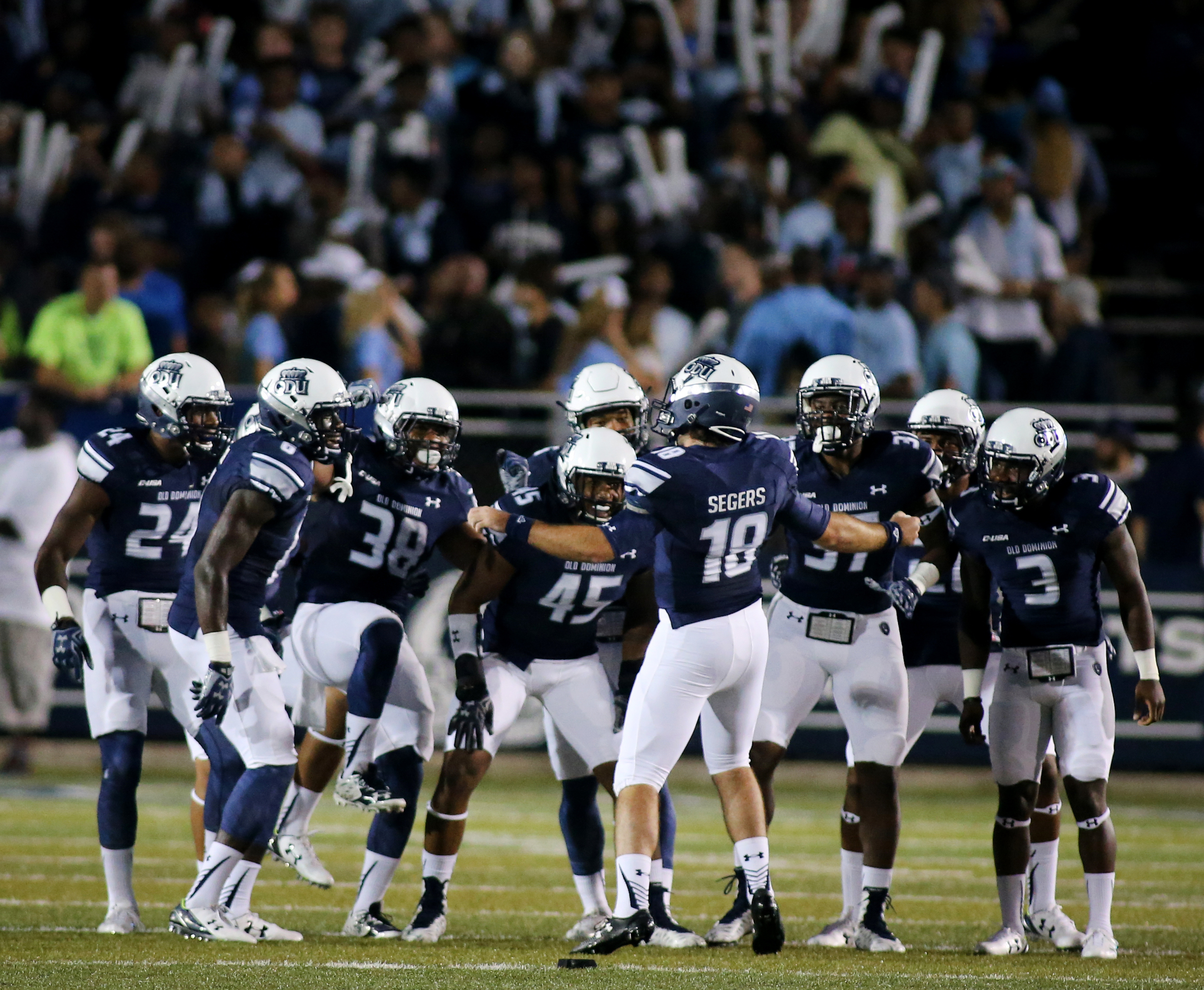 Old Dominion kicker Ricky Segers (18) gets the defense pumped up before the opening kickoff against Norfolk State, Saturday, Sept. 12, 2015 at Foreman Field in Norfolk.