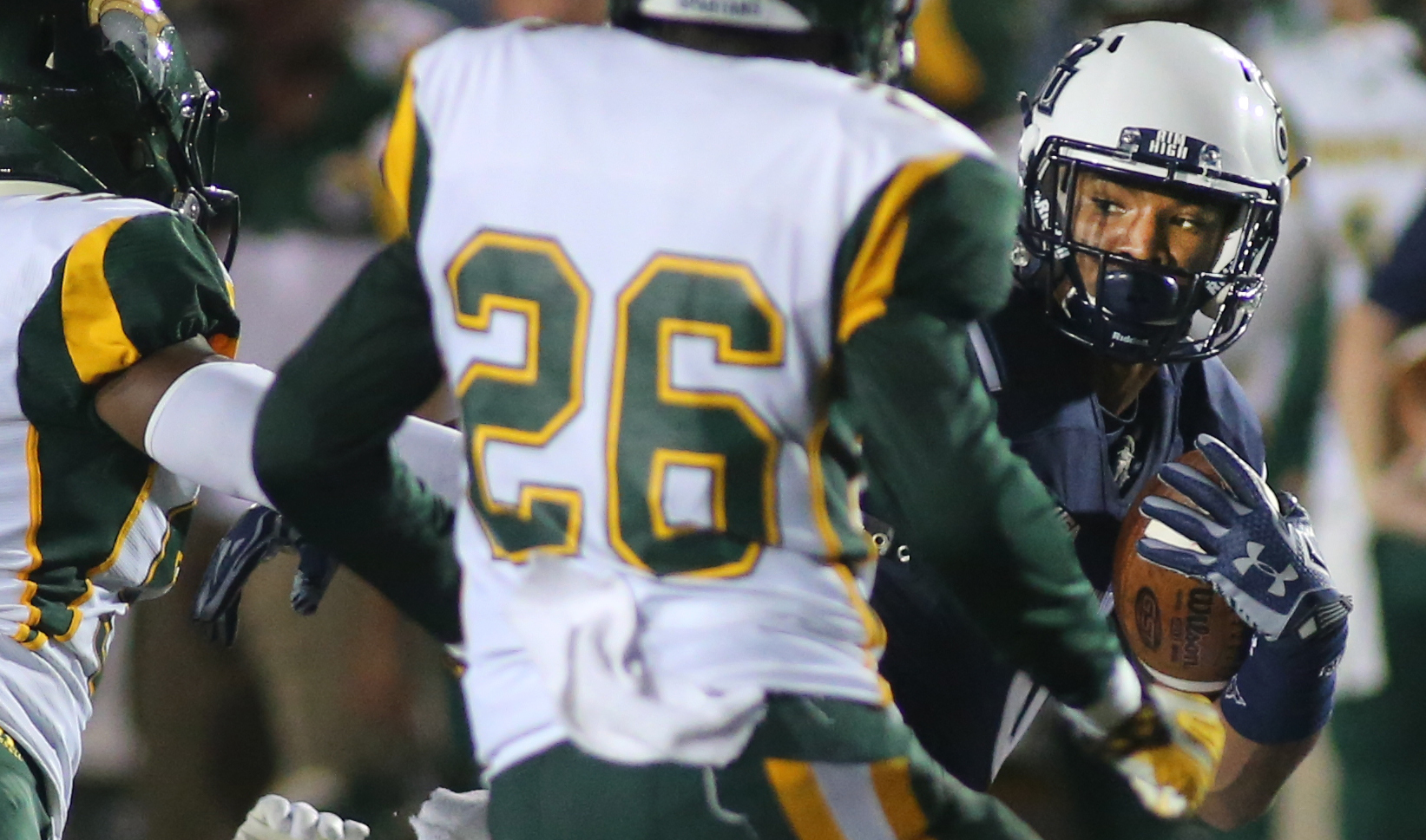 Old Dominion's Jonathan Duhart eyes Norfolk State defenders on his way to a first-quarter gain, Saturday, Sept. 12, 2015 at Foreman Field in Norfolk.