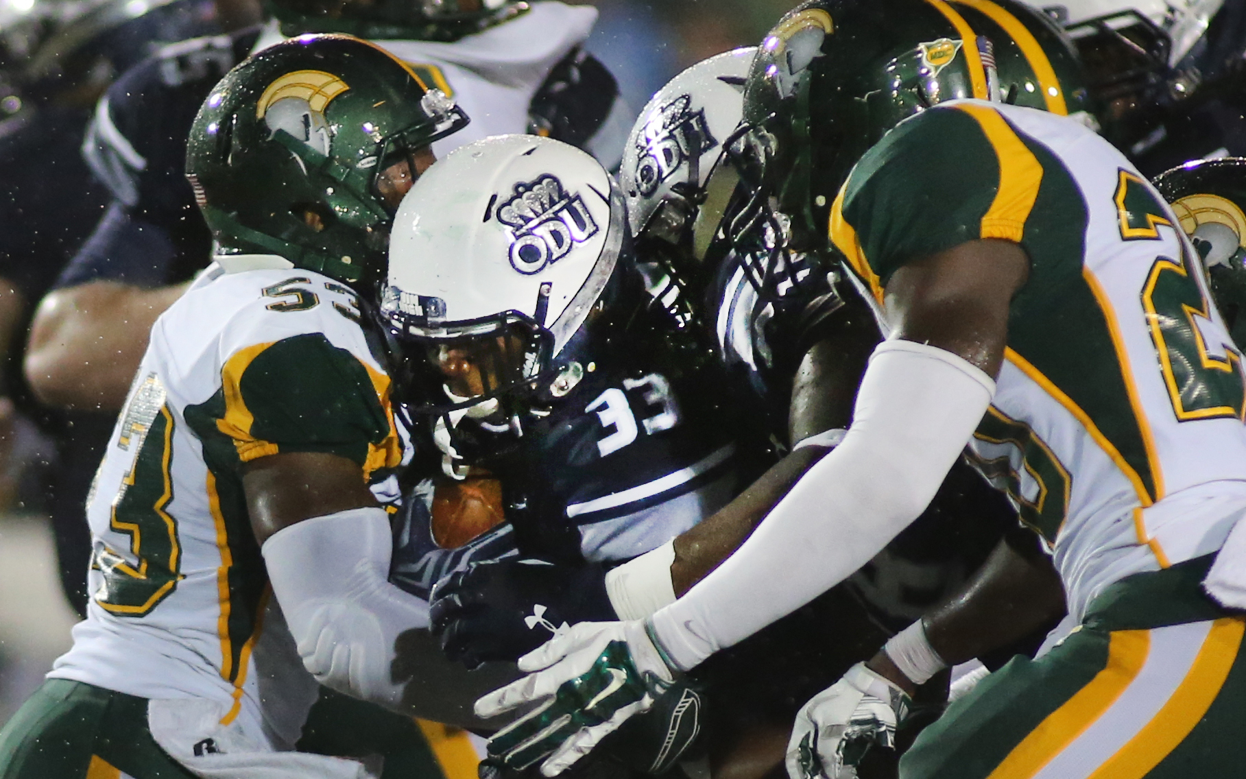 Old Dominion's Ray Lawry muscles through Norfolk State defenders Deon King, left, and Brandon Walker on his way to a second-quarter touchdown, Saturday, Sept. 12, 2015 at Foreman Field in Norfolk.