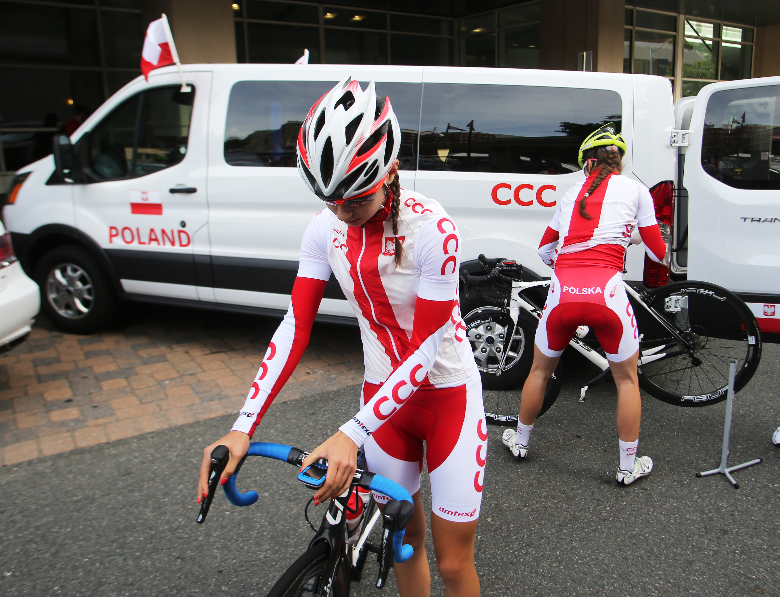 Members of the Polish cycling team make last minute adjustments before heading out for the Road Circuit Training portion of the UCI Road World Championships cycling races in Richmond, Va., Thursday, Sept. 24, 2015. (AP Photo/Jason Hirschfeld)