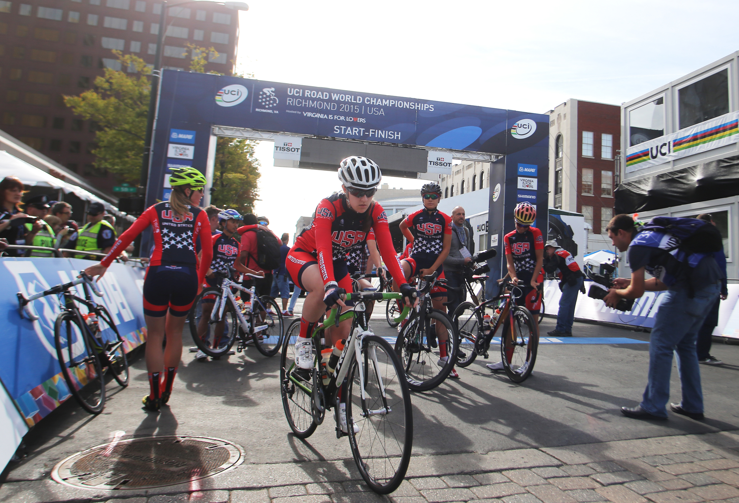 Members of the USA cycling team head out for the Road Circuit Training portion of the UCI Road World Championships cycling races in Richmond, Va., Thursday, Sept. 24, 2015. (AP Photo/Jason Hirschfeld)