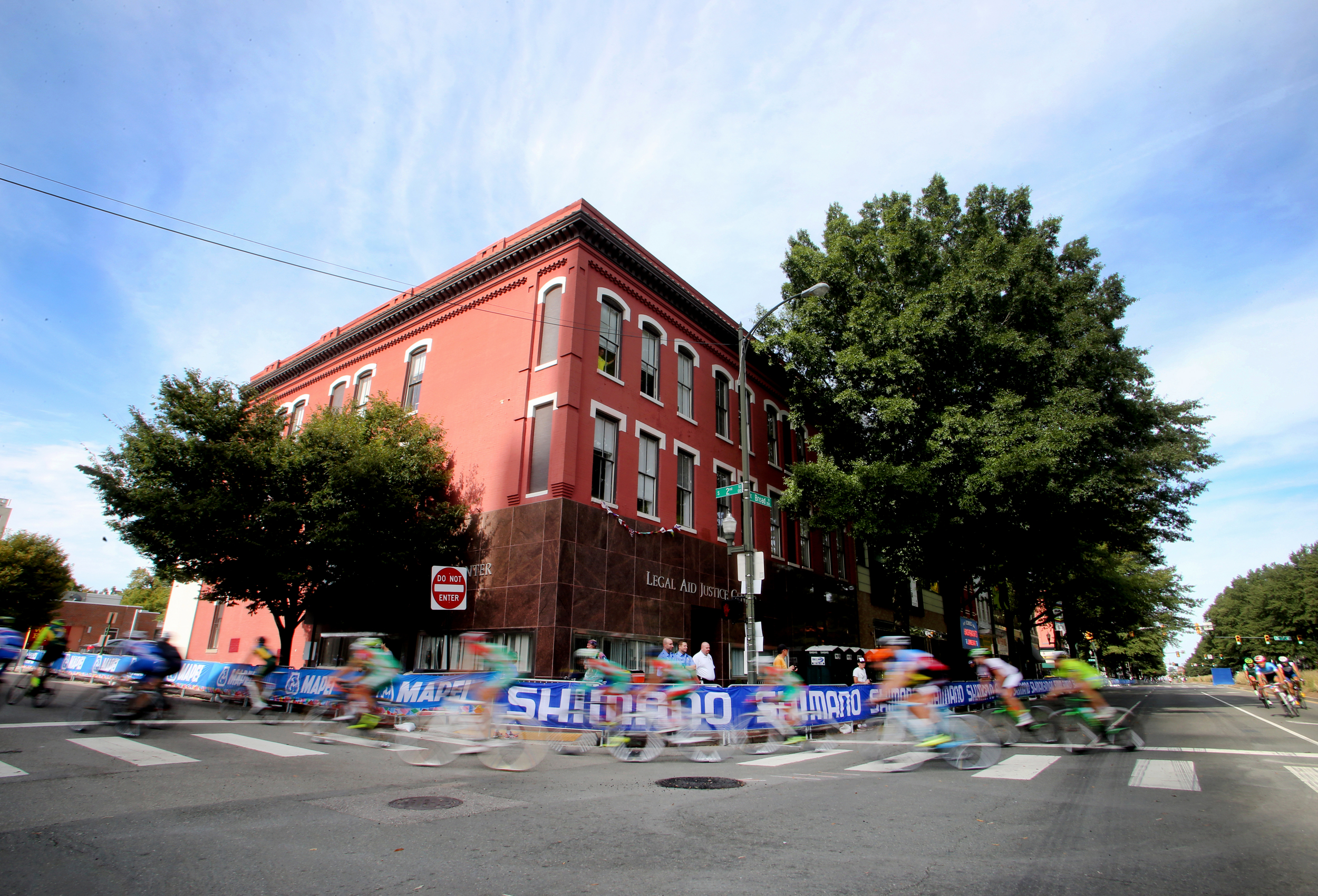 Cyclists ride in the Road Circuit Training portion of the UCI Road World Championships cycling races in Richmond, Va., Thursday, Sept. 24, 2015. (AP Photo/Jason Hirschfeld)