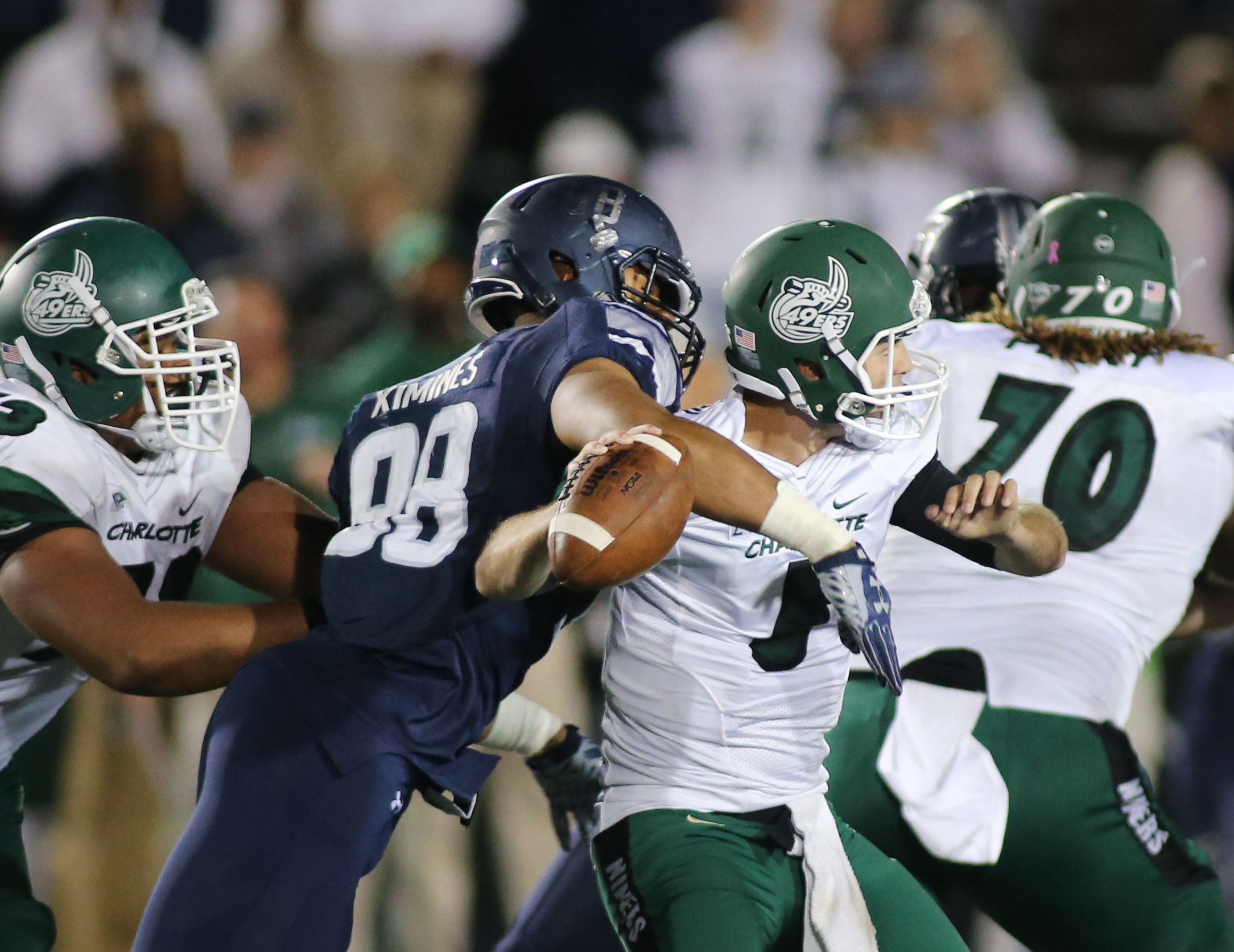 Old Dominion's Oshane Ximines sacks Charlotte quarterback Lee McNeill in the closing minutes to seal ODU's 37-34 win, Saturday, Oct. 17, 2015 at Foreman Field in Norfolk.  (Jason Hirschfeld | For The Virginian-Pilot)