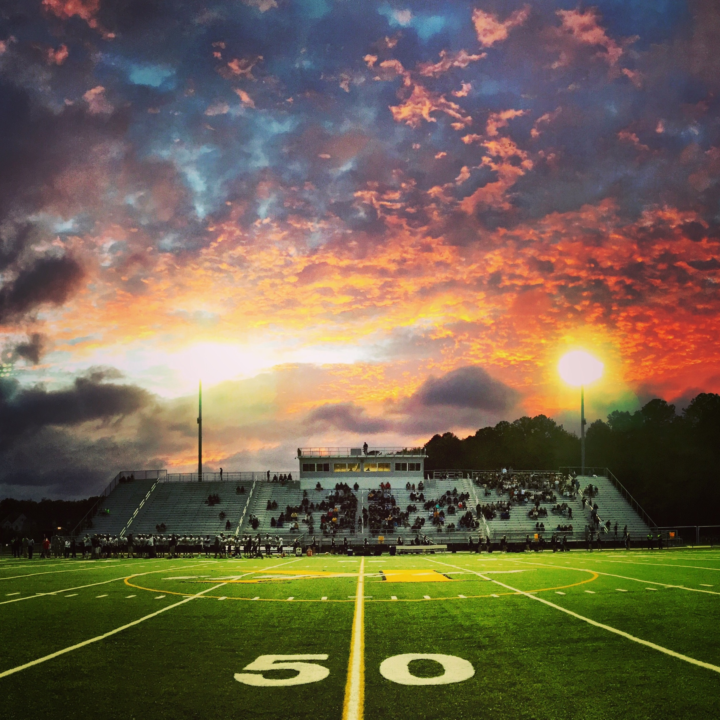 A dynamic sunset is pictured before kickoff.