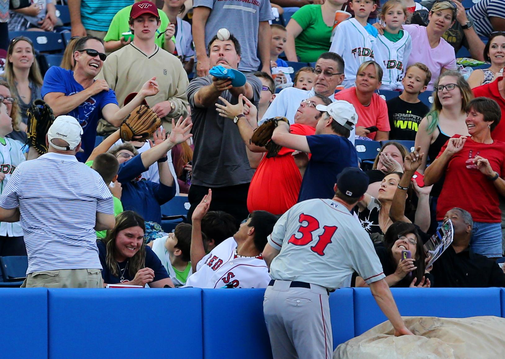 Pawtucket third baseman Jantzen Witte runs out of room on a foul ball off the bat of Norfolk's Christian Walker, Friday, June 3, 2016 at Harbor Park in Norfolk.