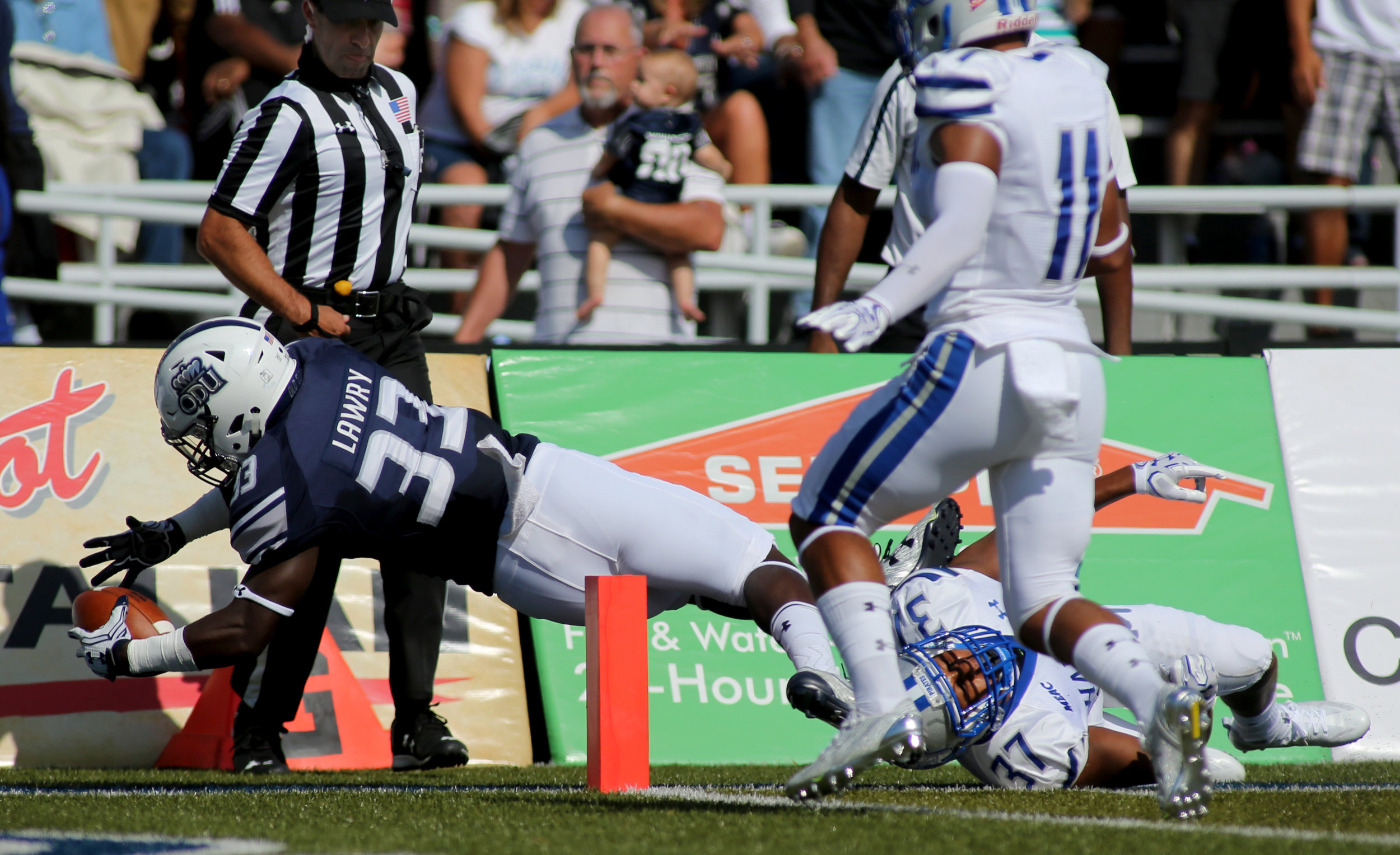 Old Dominion's Ray Lawry dives across the pylon for a first half touchdown over Hampton, Sunday, Sept. 4, 2016 at Foreman Field in Norfolk.   (Jason Hirschfeld | The Virginian-Pilot)