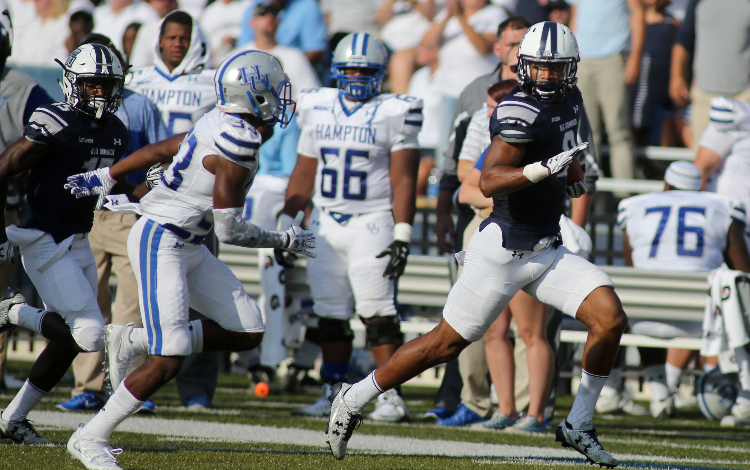 Old Dominion's Jonathan Duhart runs for a third quarter gain past Hampton's Dereon Carr during ODU's 54-21 win, Sunday, Sept. 4, 2016 at Foreman Field in Norfolk.   (Jason Hirschfeld | The Virginian-Pilot)