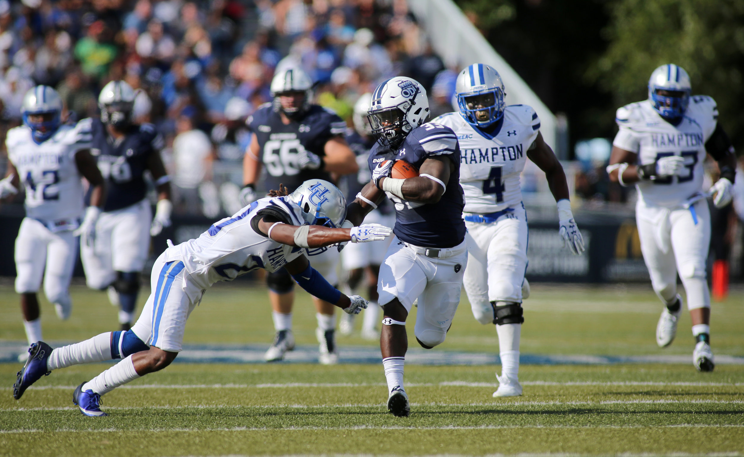 Old Dominion's Ray Lawry finds a seam past Hampton defender Myles Morris for a second quarter gain, Sunday, Sept. 4, 2016 at Foreman Field in Norfolk.   (Jason Hirschfeld | The Virginian-Pilot)