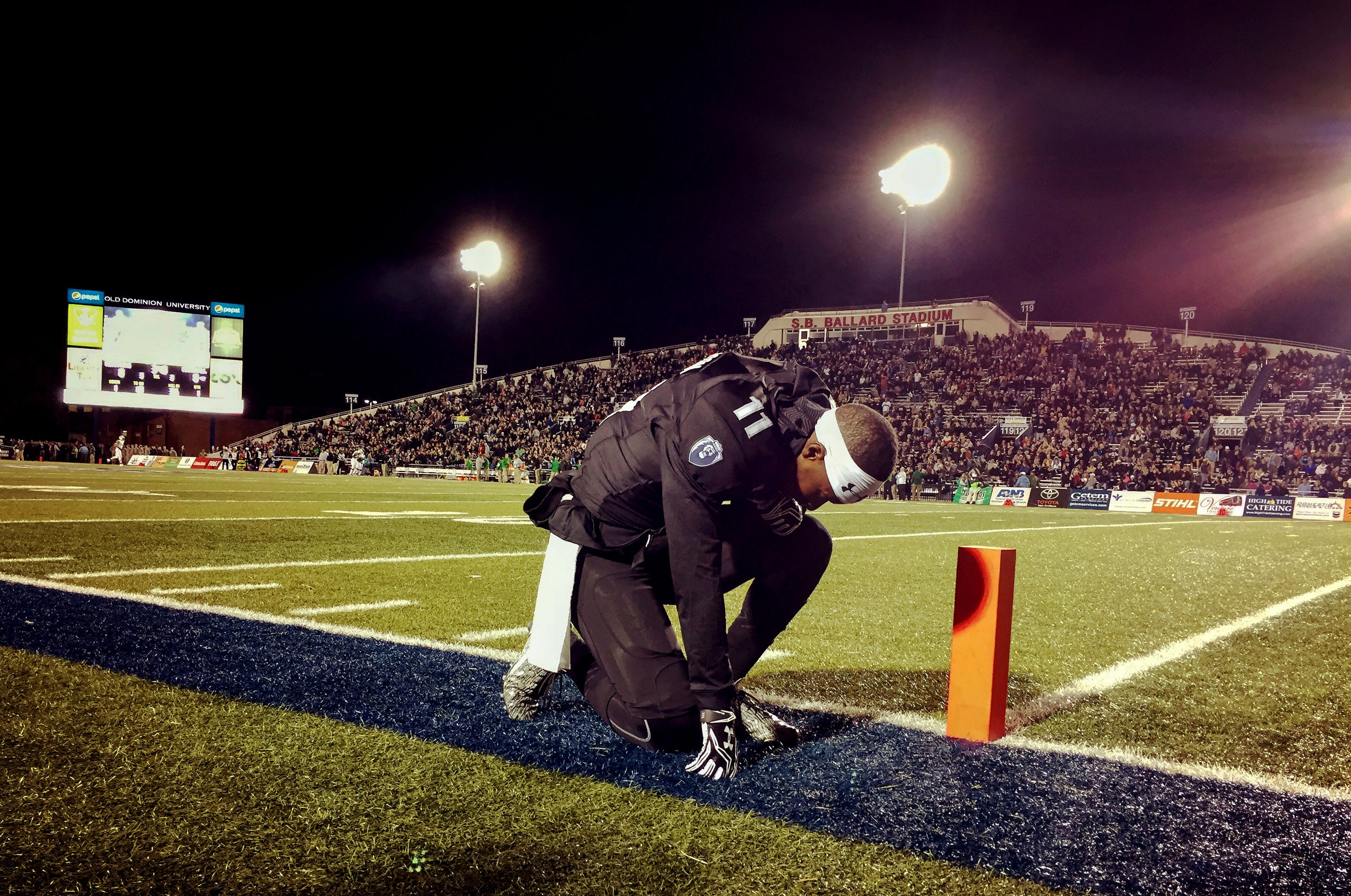 Old Dominion's Brandon Addison takes a moment before the start of the their game against Marshall, Saturday, Nov. 5, 2016 at Foreman Field in Norfolk.