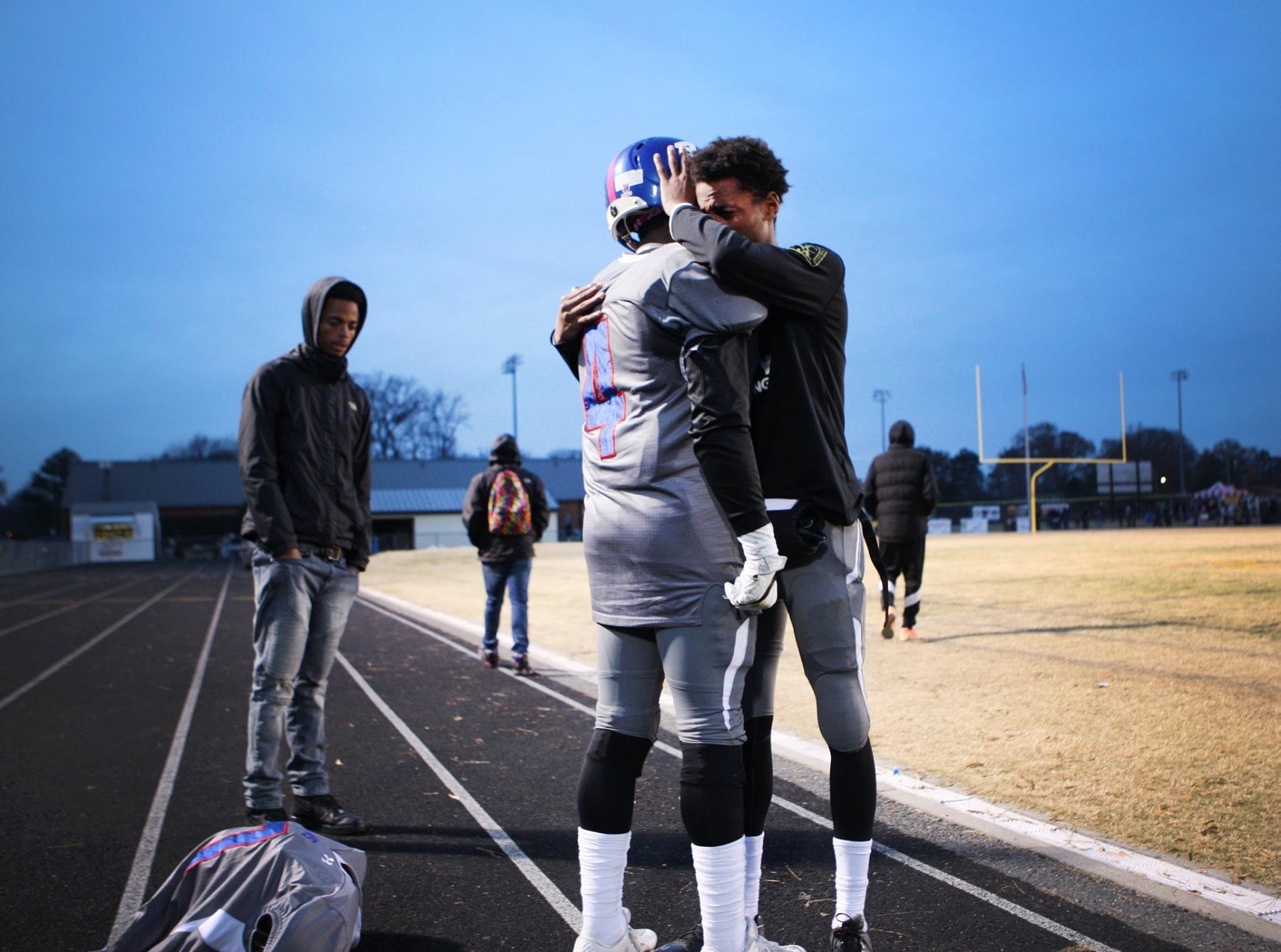 Norview's Kavon Lawson (4) and teammate Jamal Deaton embrace after losing to Highland Springs in the 5A South Region championship game, Saturday, Dec. 4, 2016 in Highland Springs, Va.