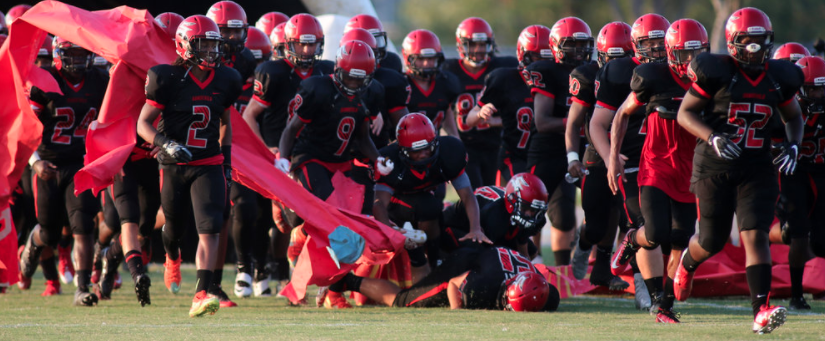 Salem's Jacob Bryant, bottom center, faceplants as the Sun Devils take the field prior to the start of their game against Ocean Lakes, Friday, Aug. 26, 2016 at Salem High School in Virginia Beach.