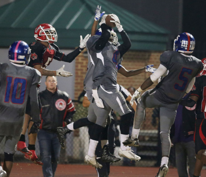 Norview's Kavon Lawson hauls in a last second heave by Hampton as time expired during their 37-31 5A South Region semifinal win, Friday, Nov. 25, 2016 at Darling Stadium in Hampton.