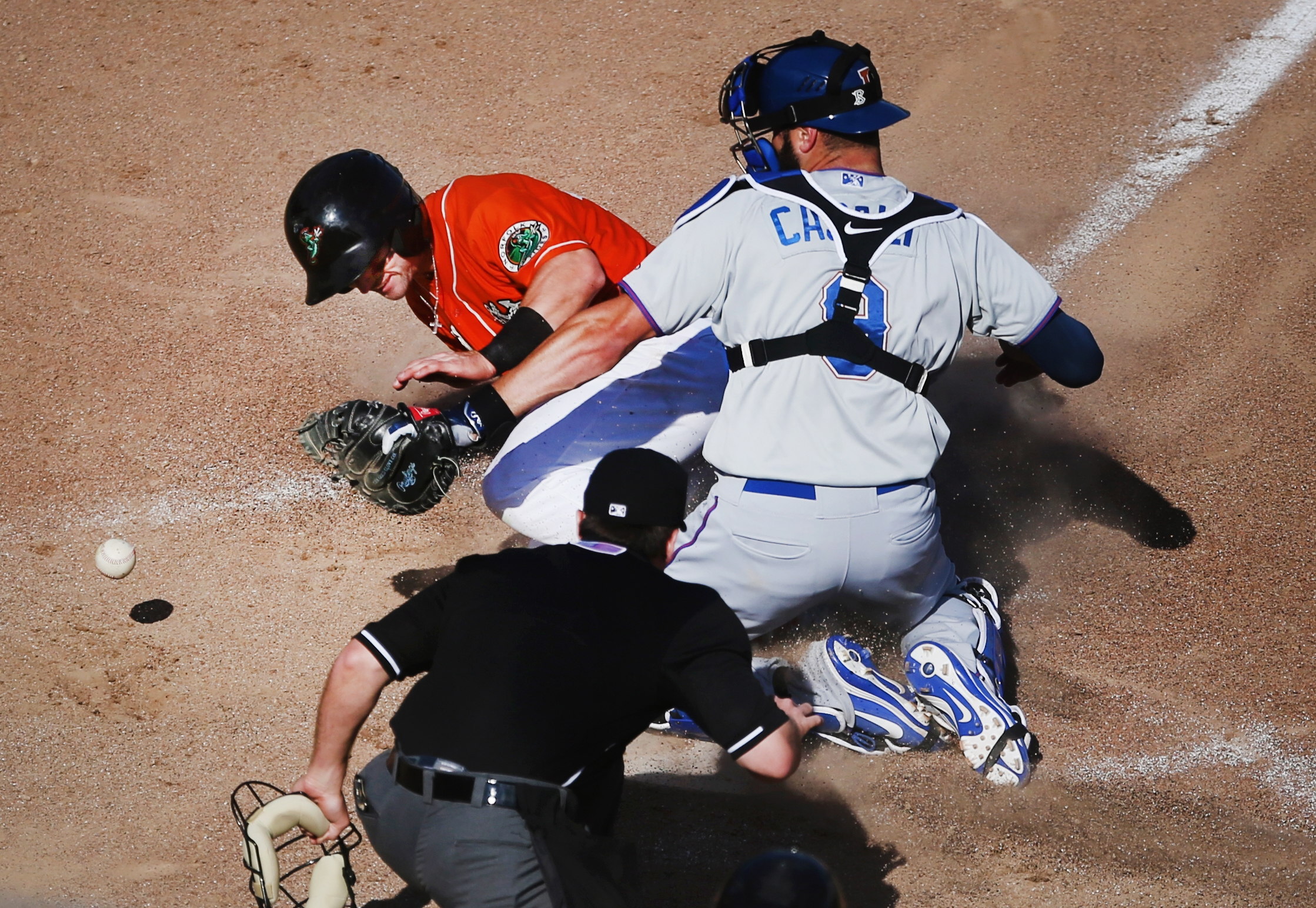 Norfolk's Johnny Giavotella scores the winning run on a 4-3 12th inning walk off double by teammate Mike Yastrzemski as Durham catcher Curt Casali can't corral the the ball, Sunday, May 7, 2017 at Harbor Park in Norfolk.