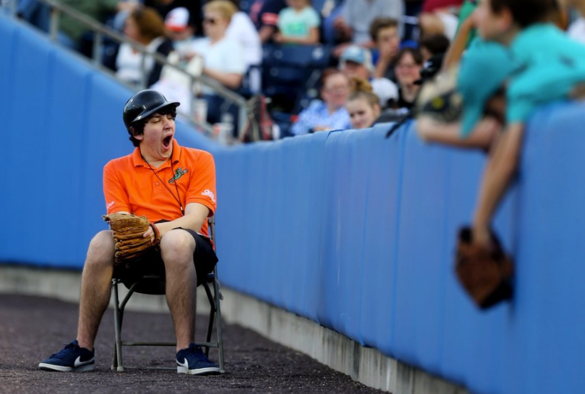 A Tides gameday worker yawns on Opening Night against Gwinnett at Harbor Park in Norfolk.