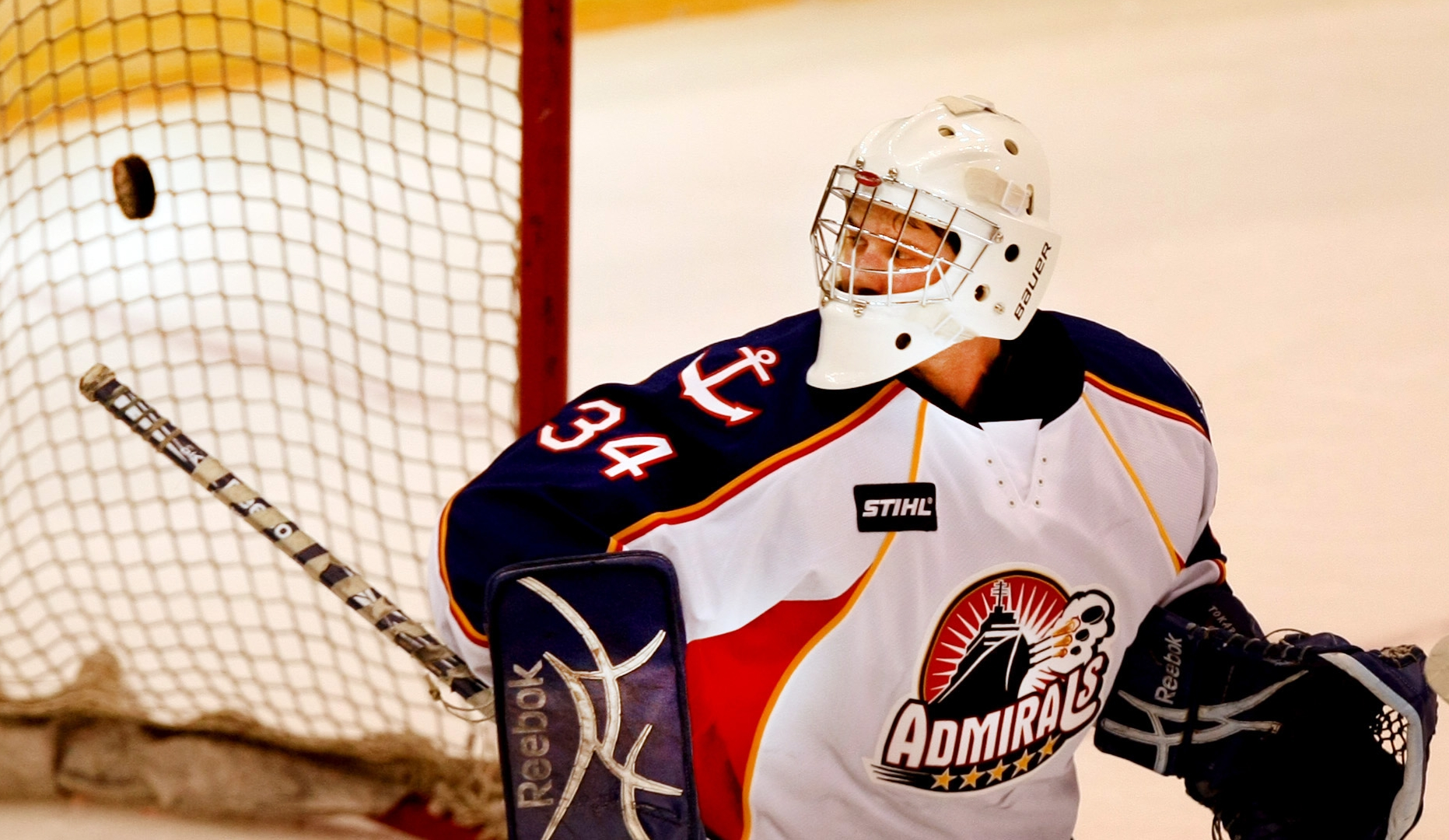 Admirals goalie Dustin Tokarski watches the puck go into net for a Wilkes-Barre/Scranton goal to tie the game at two at Scope in Norfolk.