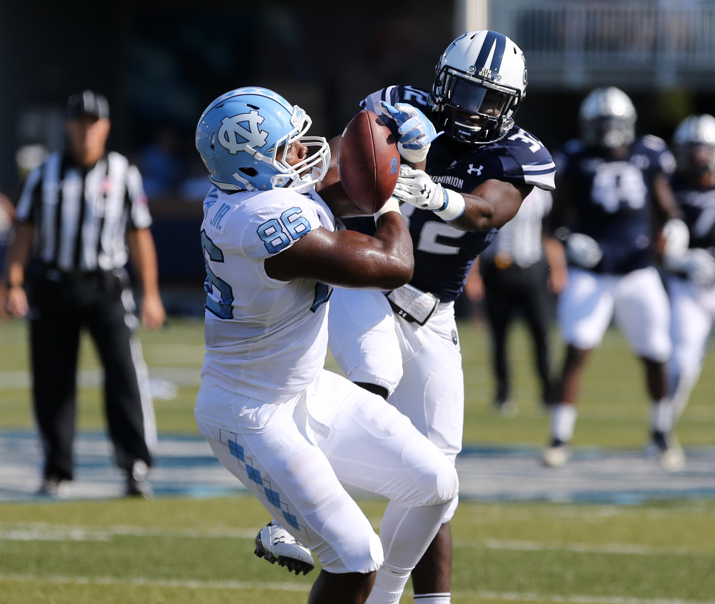 Old Dominion's Jordan Young (32) breaks up a pass intended for UNC's Carl Tucker (86) during the first half of an NCAA college football game, Saturday, Sept. 16, 2017 in Norfolk, Va.