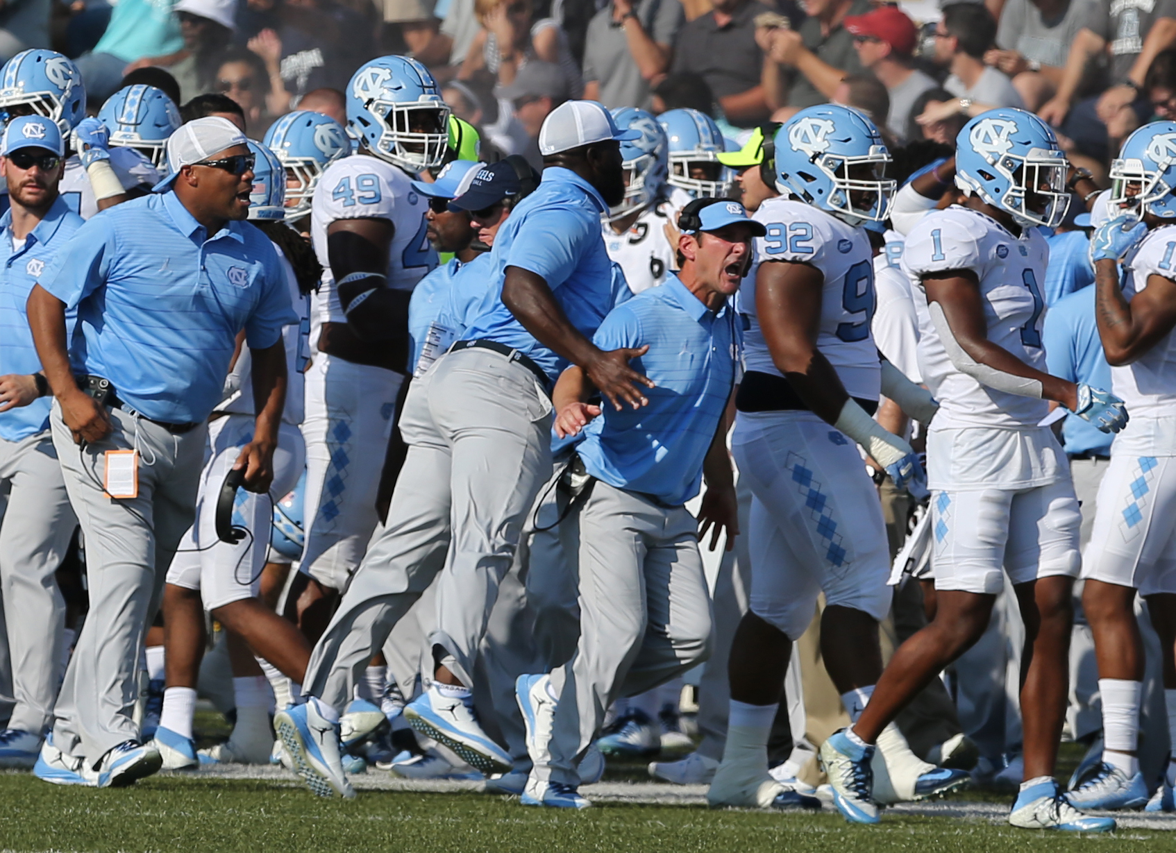 The UNC sideline erupts after the Tarheels forced an Old Dominion fumble in the second half of an NCAA college football game, Saturday, Sept. 16, 2017 in Norfolk, Va.
