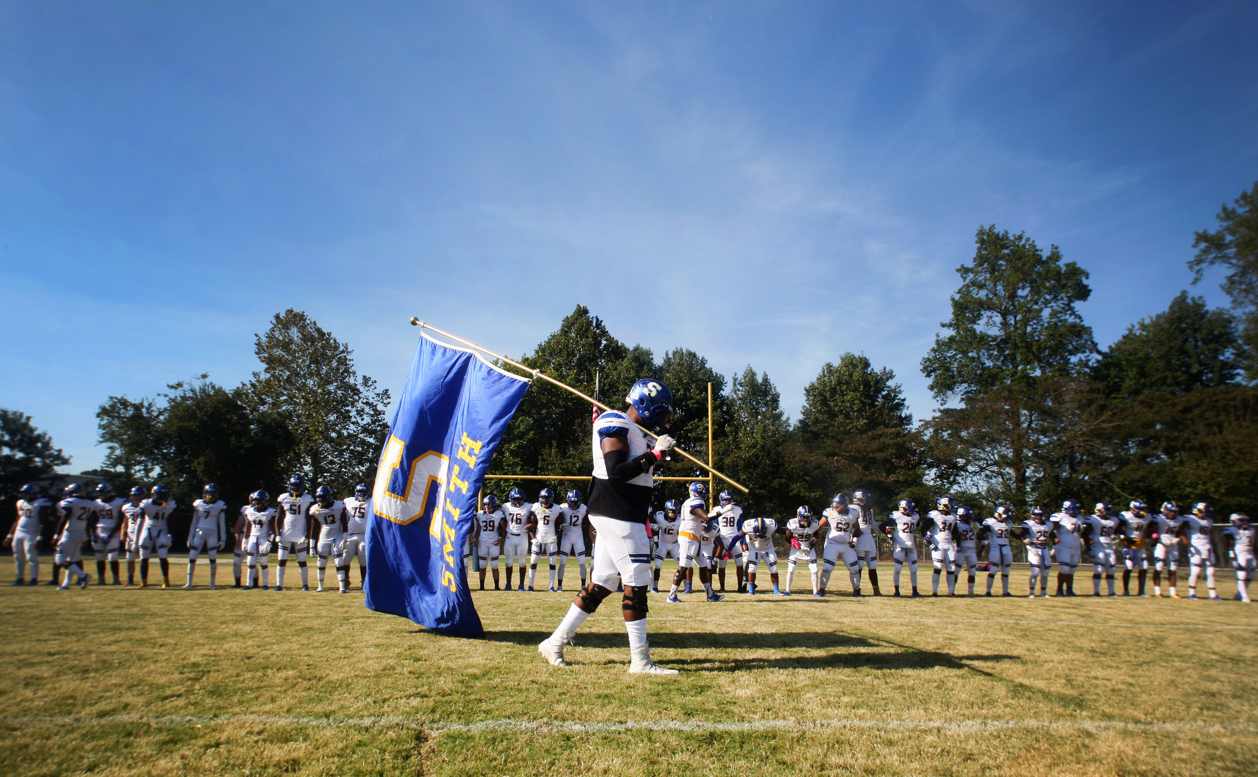 The Oscar Smith football team readies to take the field prior to the start of their 35-14 win over Indian River, Saturday, Oct. 21, 2017 at Indian River High School in Chesapeake.