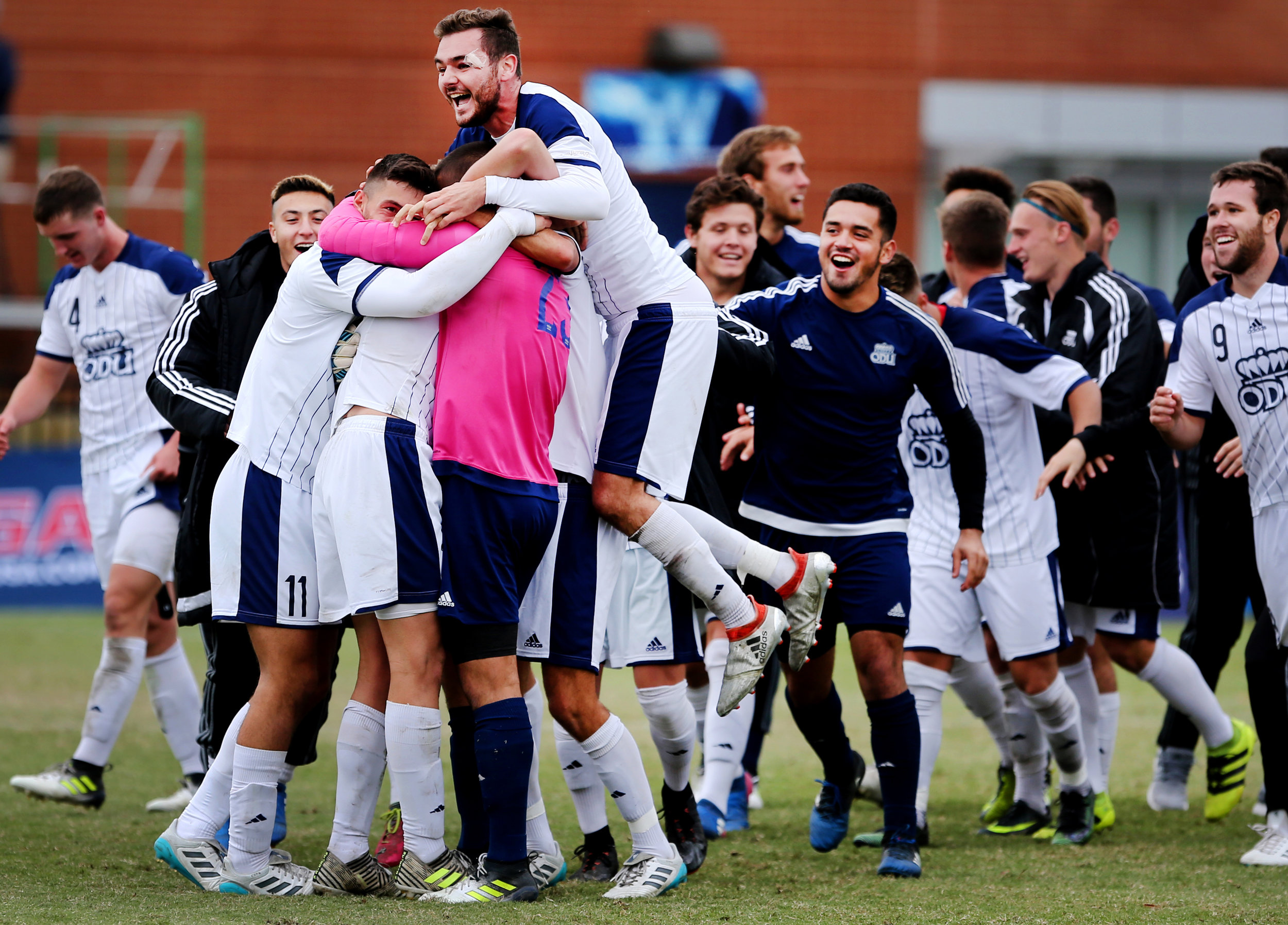 Old Dominion teammates celebrate their 1-0 win over Charlotte to claim the C-USA soccer championship, Sunday, Nov. 12, 2017 in Norfolk.