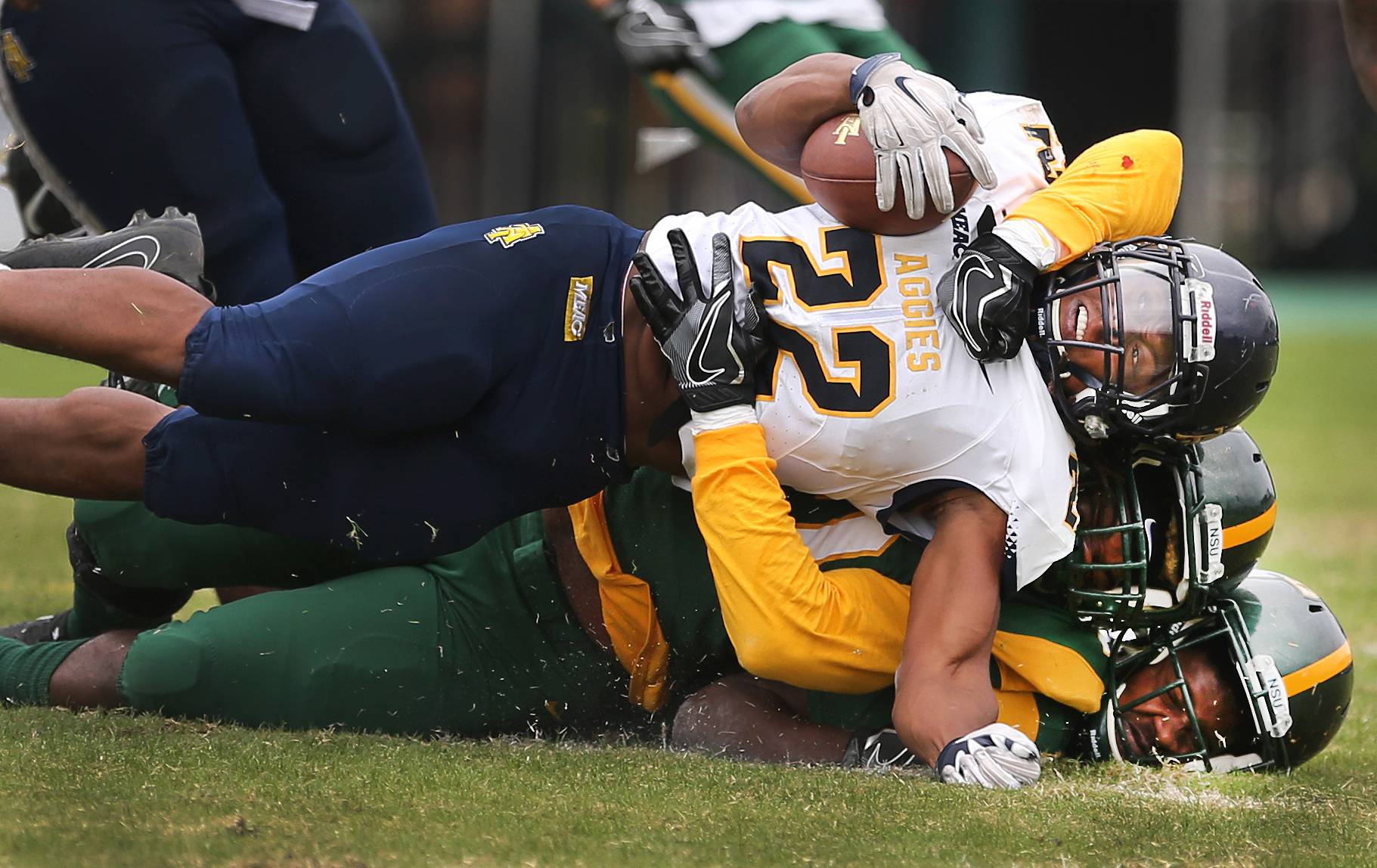 North Carolina A&T's Marquell Cartwright is brought down by Hadji Gaylord as teammate Anton Ashby is pancaked at the bottom during the Spartans' 35-7 loss, Saturday, Nov. 4, 2017 at Dick Price Stadium in Norfolk.