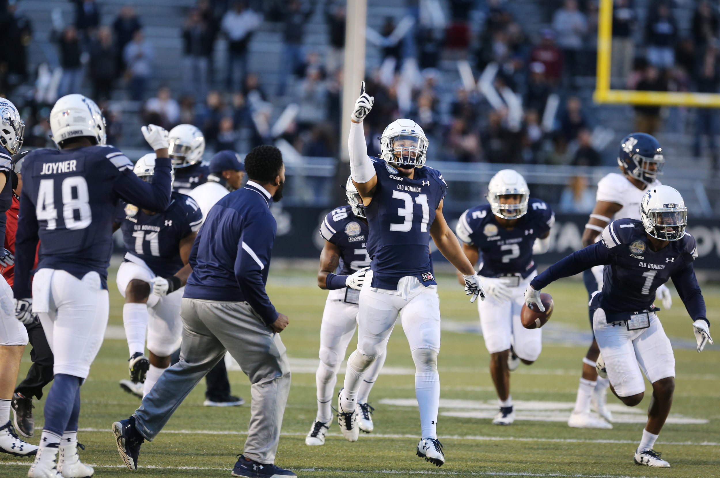 Old Dominion's Sean Carter, center, celebrates after intercepting a pass intended for a Rice receiver to seal ODU's 24-21 win over Rice in the closing seconds of the fourth quarter, Saturday, Nov. 18, 2017 at Foreman Field in Norfolk.
