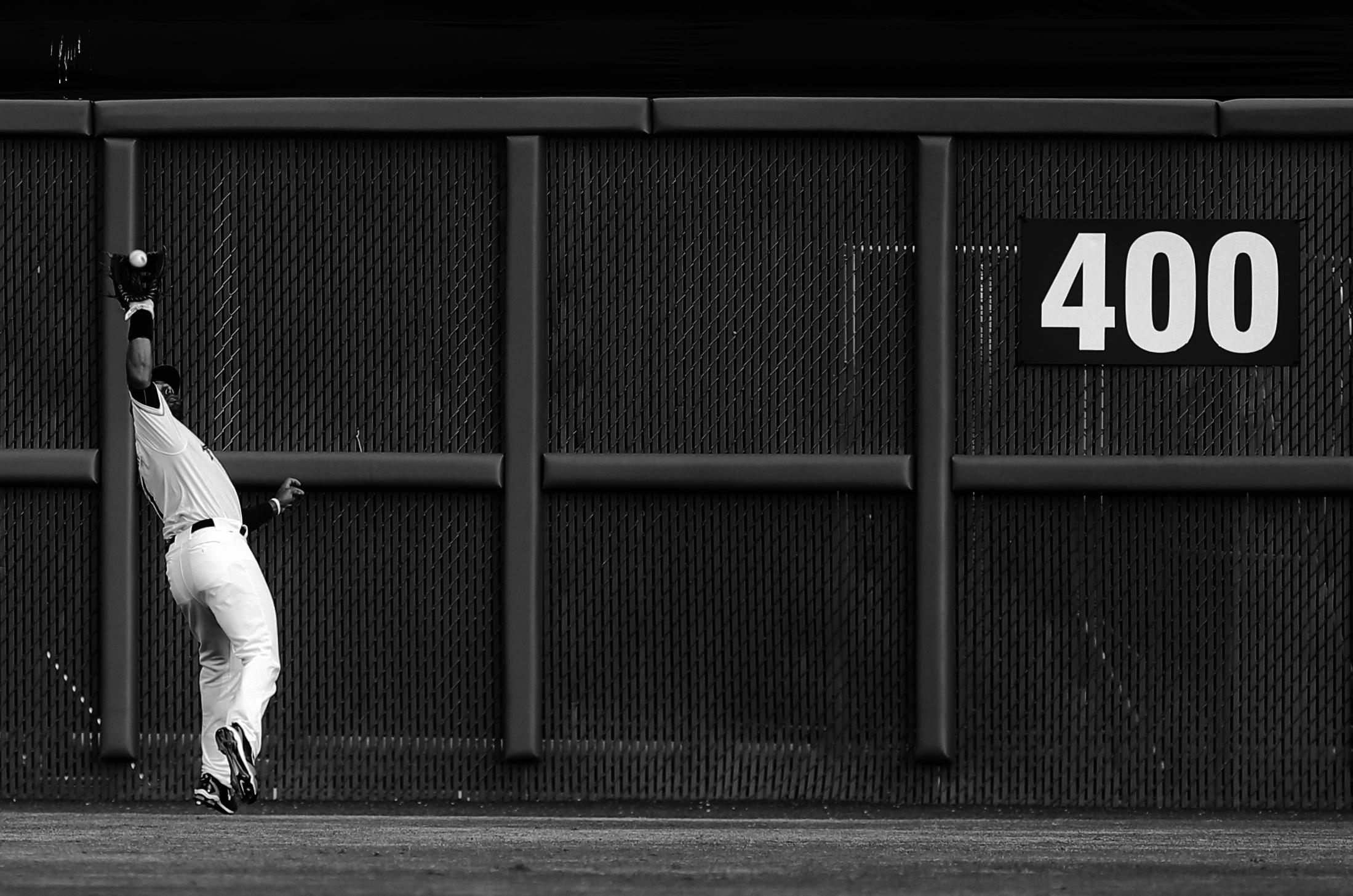 Tides centerfielder Chris Dickerson hauls in a fly ball off the bat of Gwinnett's Ozzie Albies in Norfolk.