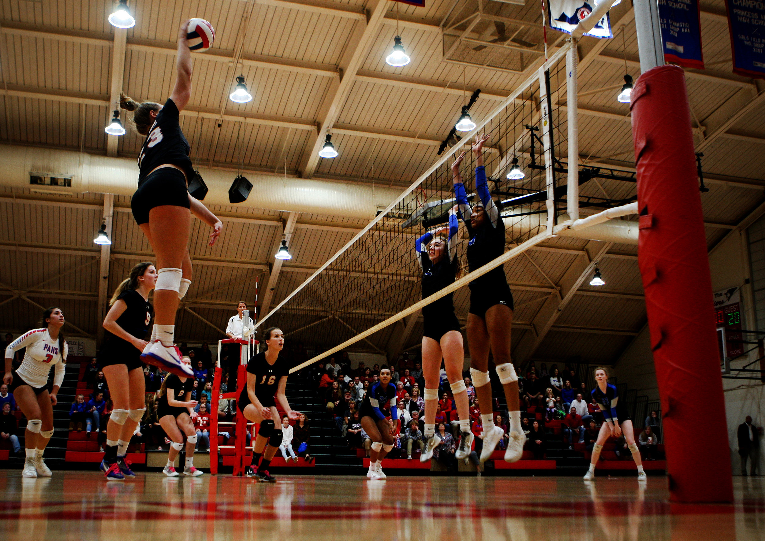 Princess Anne's Jayna Francis soars and drills a winner past Atlee's Olivia Guridy and Brianna Brown, right, during the Cavaliers' three-set sweep in the Class 5 state semifinal.