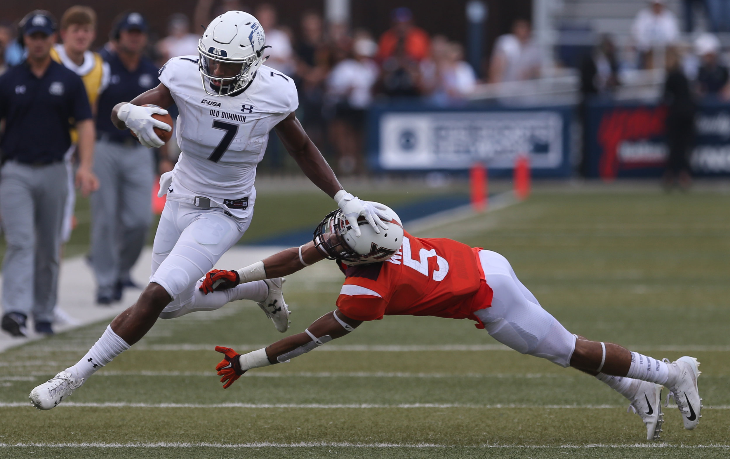 Old Dominion's Travis Fulgham, left, stiff arms Virginia Tech's Bryce Watts during the second half of an NCAA college football game, Saturday, Sept. 22, 2018, in Norfolk, Va. Old Dominion won 49-35. (AP Photo/Jason Hirschfeld)