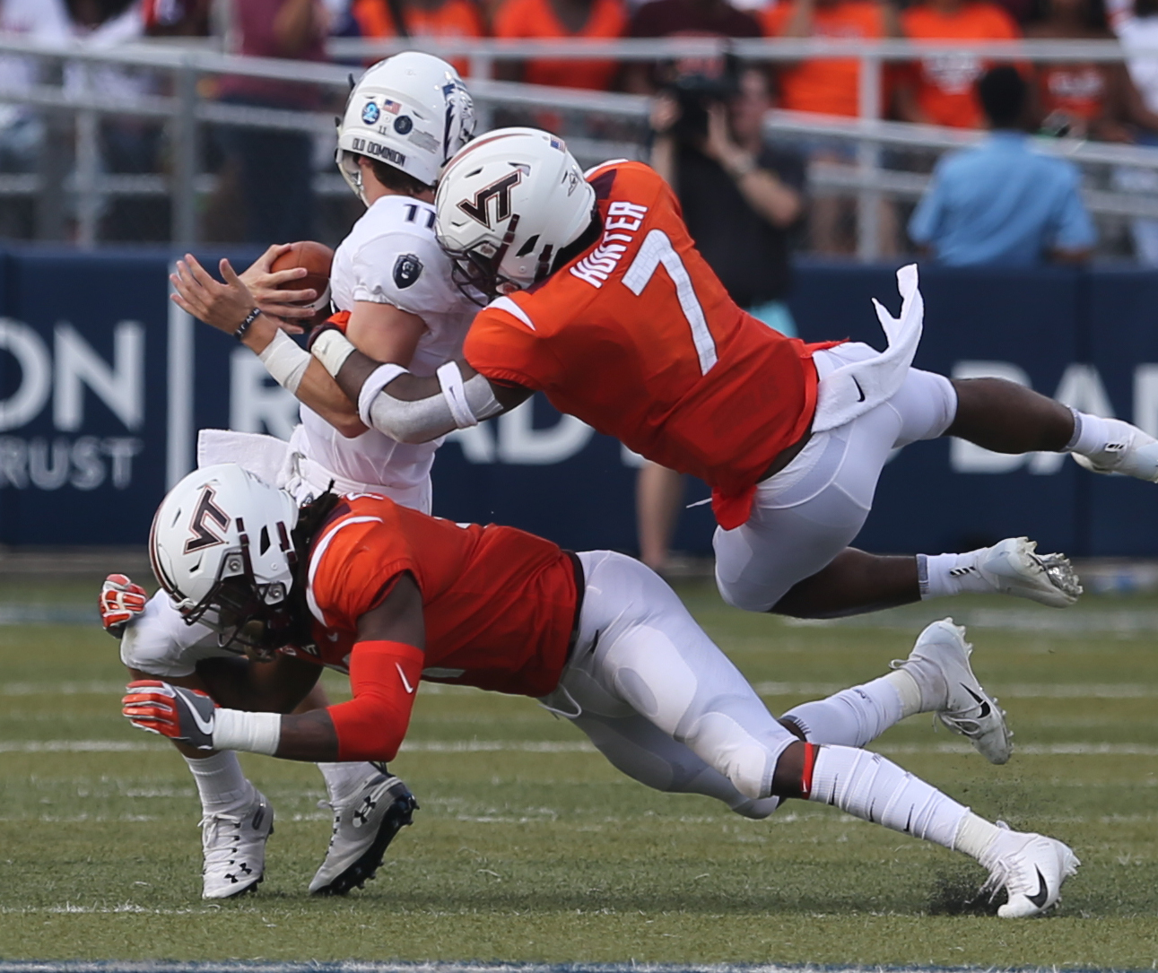 Old Dominion's Blake LaRussa gets wrapped up by Virginia Tech's Devon Hunter (7) and Reggie Floyd (21) during the second half of an NCAA college football game, Saturday, Sept. 22, 2018, in Norfolk, Va. Old Dominion won 49-35. (AP Photo/Jason Hirschfeld)