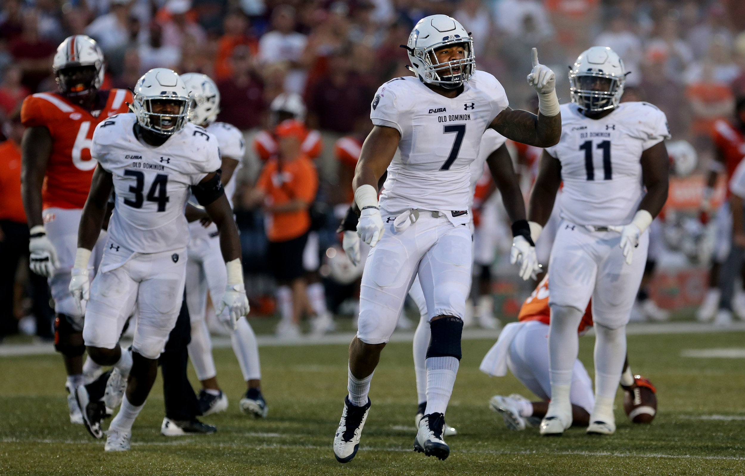 Old Dominion's Oshane Ximines reacts after a first down during the second half of an NCAA college football game, Saturday, Sept. 22, 2018, in Norfolk, Va. Old Dominion won 49-35. (AP Photo/Jason Hirschfeld)