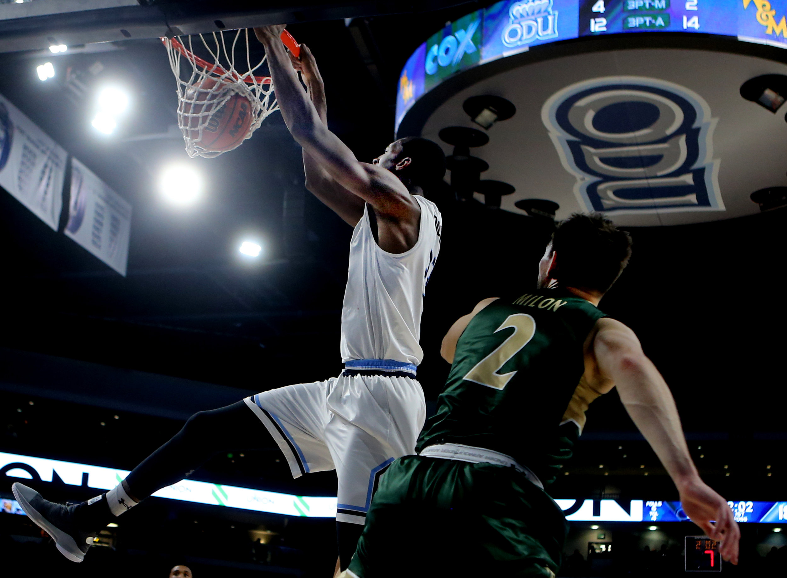 Old Dominion's Dajour Dickens dunks over William & Mary's Matt Milon during first half action, Wednesday, December 5, 2018 at the Constant Center in Norfolk.