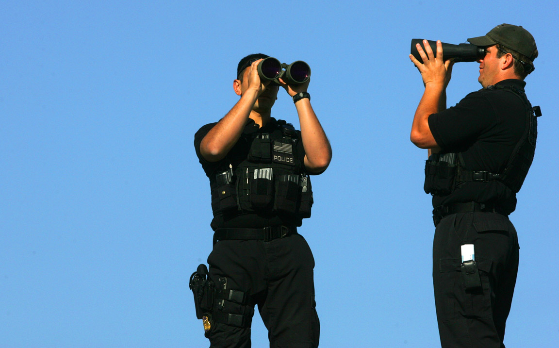 Secret Service officers scan the area from an above platform during an Obama campaign stop in Virginia Beach, Va.