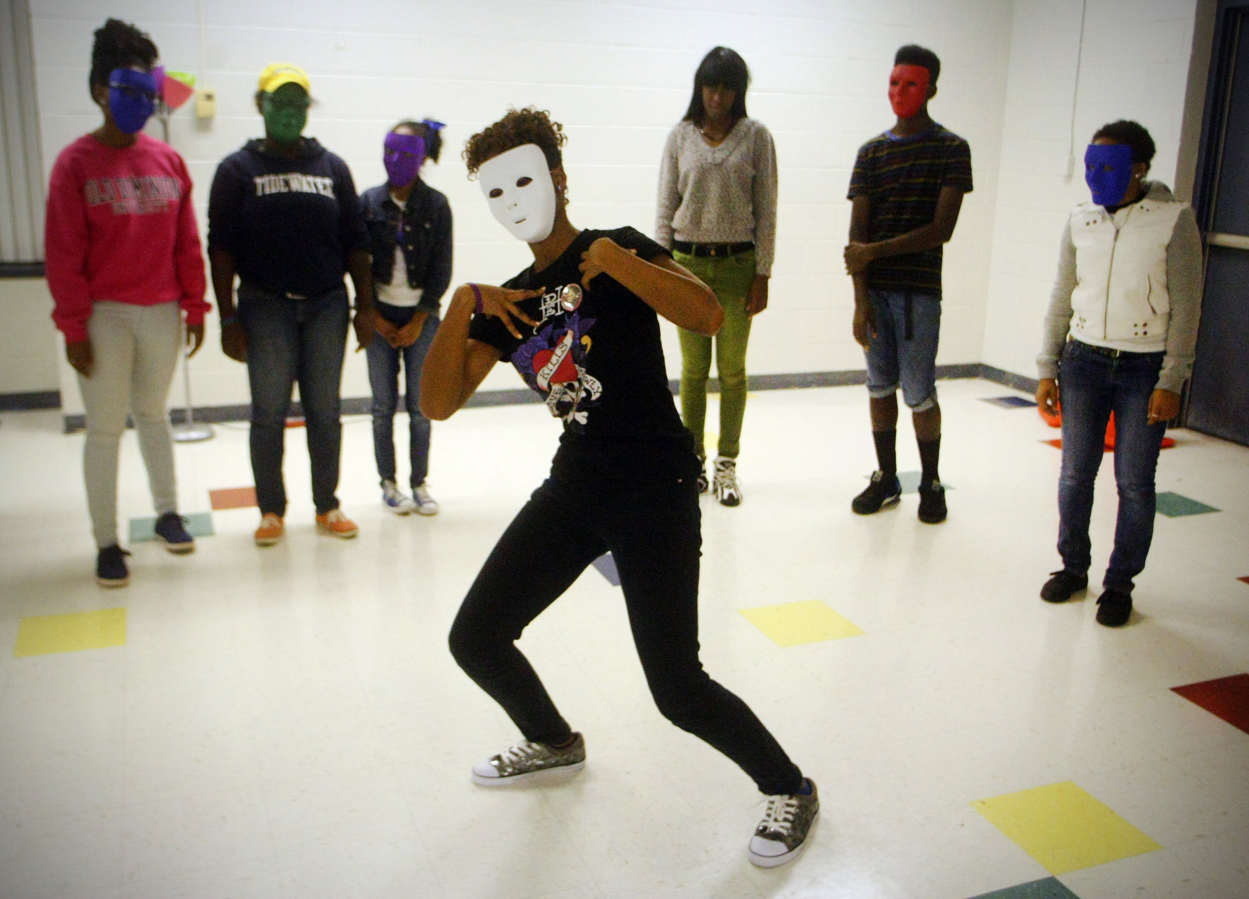 Zipporah Dailey, center, performs mime during the talent portion of the Teens With A Purpose.