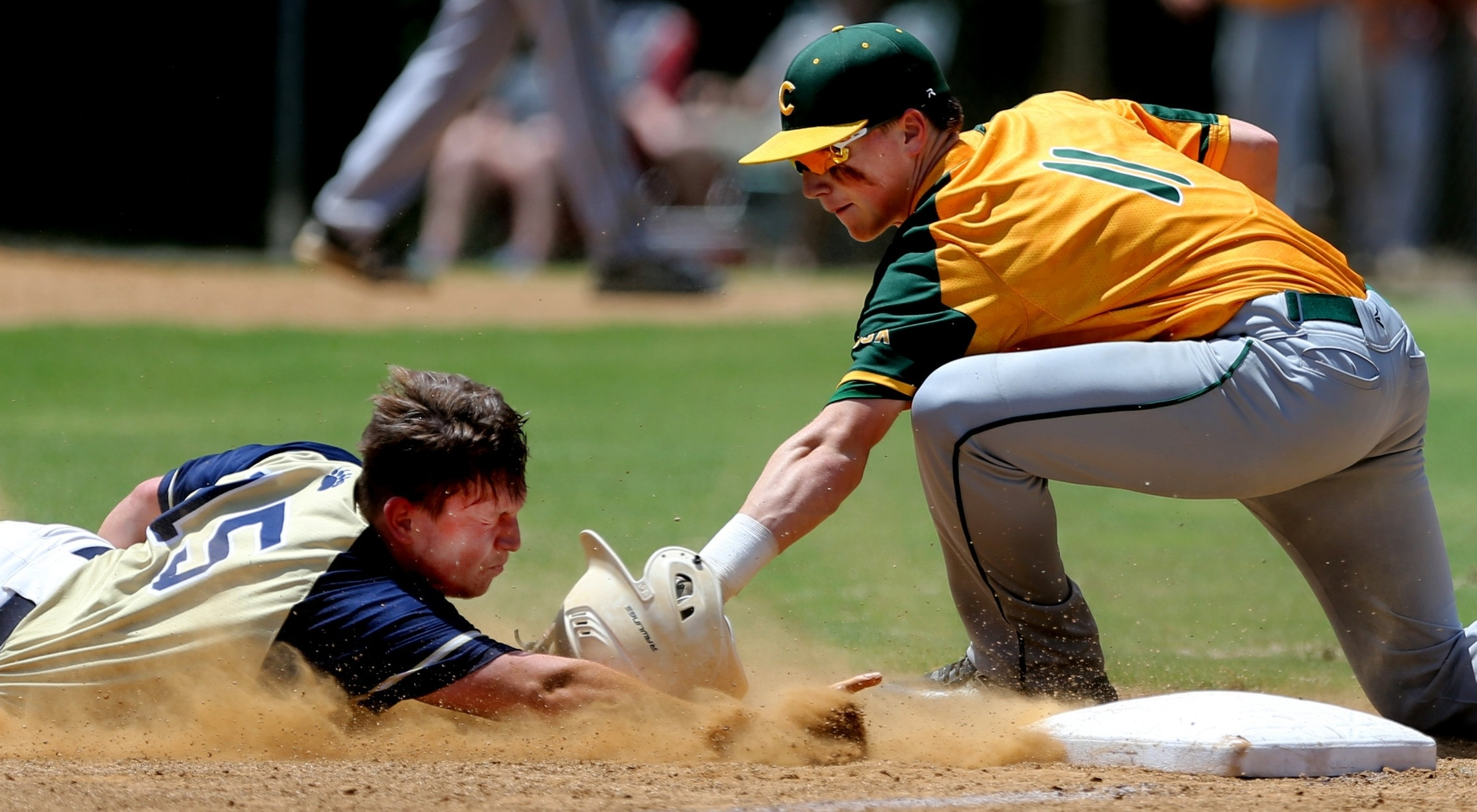 Western Branch's Connor Epley slides safely into third base ahead of the tag by Cox's South Trimble.