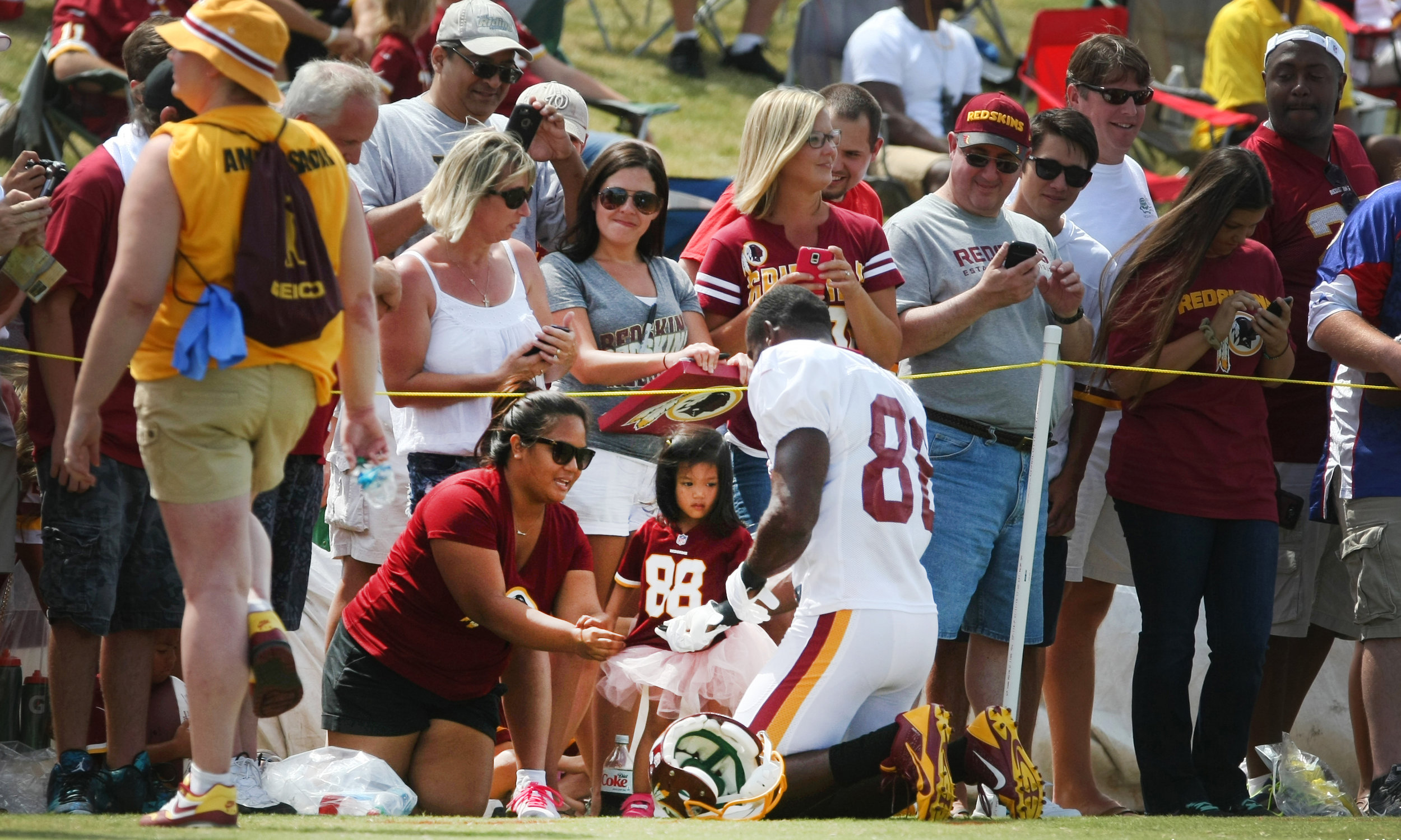 Washington Redskins wide receiver Pierre Garcon signs an autograph during the team's NFL football training camp in Richmond, Va., Sunday, Aug. 2, 2015.
