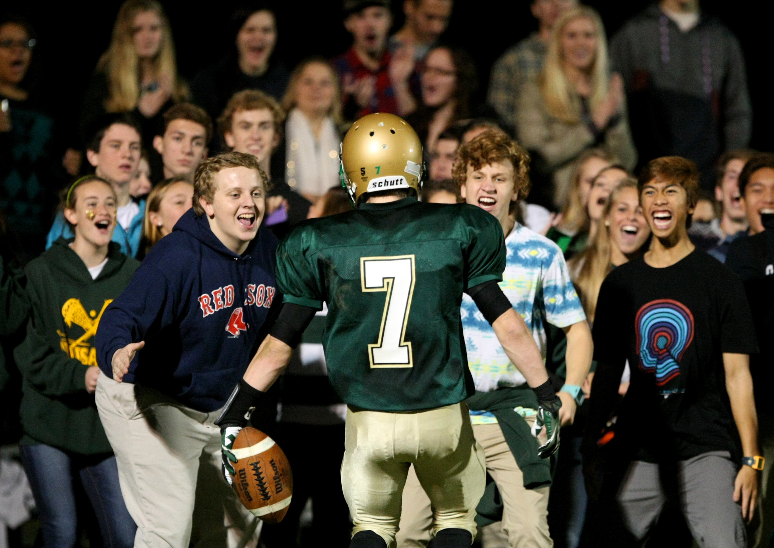 Bishop Sullivan's Liam Korka celebrates with the student section after scoring a second-quarter touchdown while playing Potomac School in the VISAA Division II state championship game, Saturday, Nov. 16, 2013 at Bishop Sullivan Catholic School in Virginia Beach. Bishop Sullivan won 50-44.