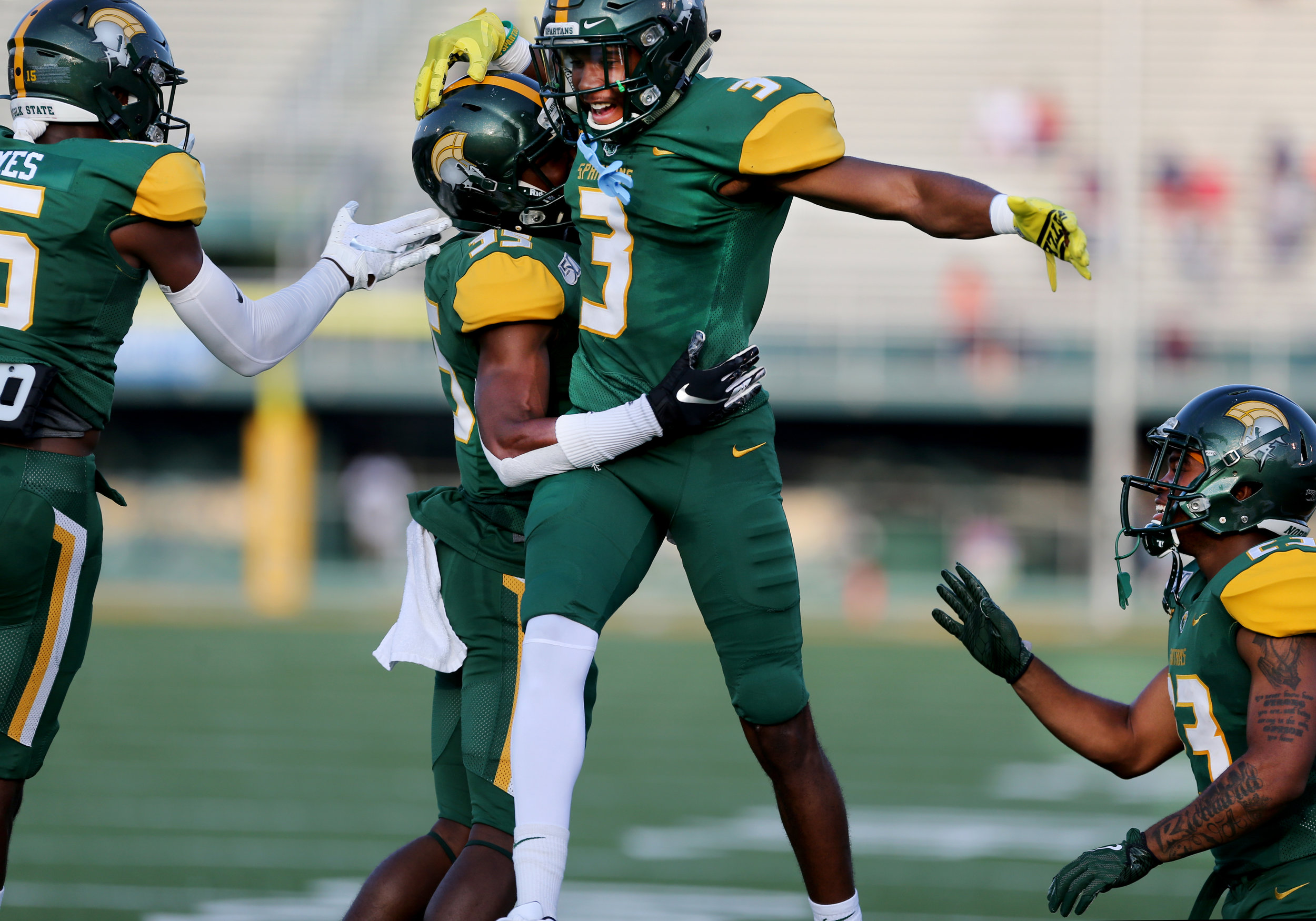 Norfolk State players celebrate with Kevin Johnson, second from left, after Johnson scored his first collegiate touchdown with a carry of 33 yards against Virginia State, Saturday, September 7, 2019 at Dick Price Stadium in Norfolk.